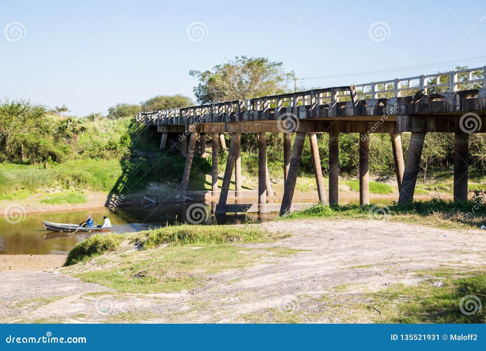 National Route 9 highway runs over a river bridge in Paraguayan Gran Chaco savannah, Paraguay. Ruta Nacional Transchaco.