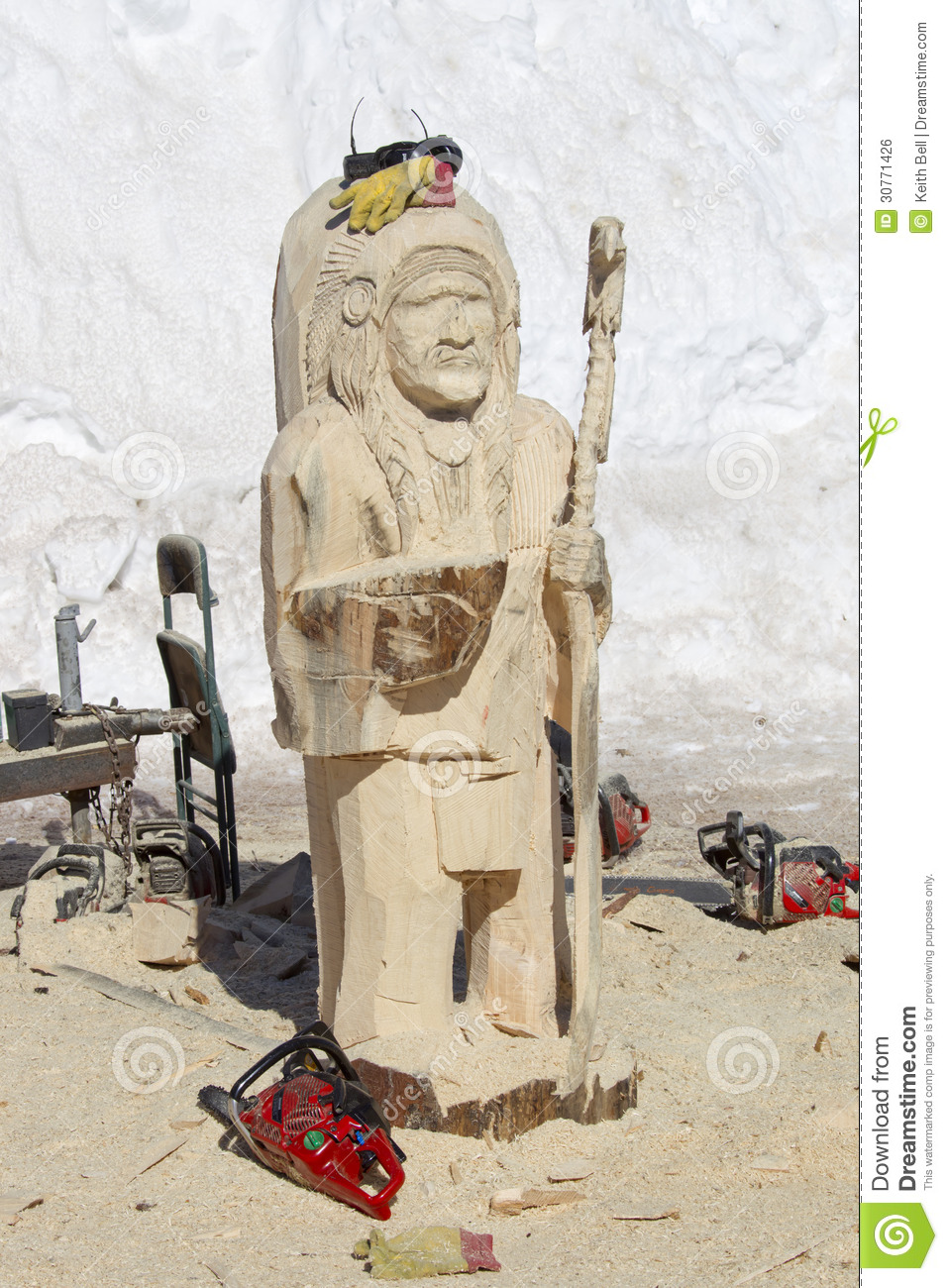 Native american indian chief wood carving in process