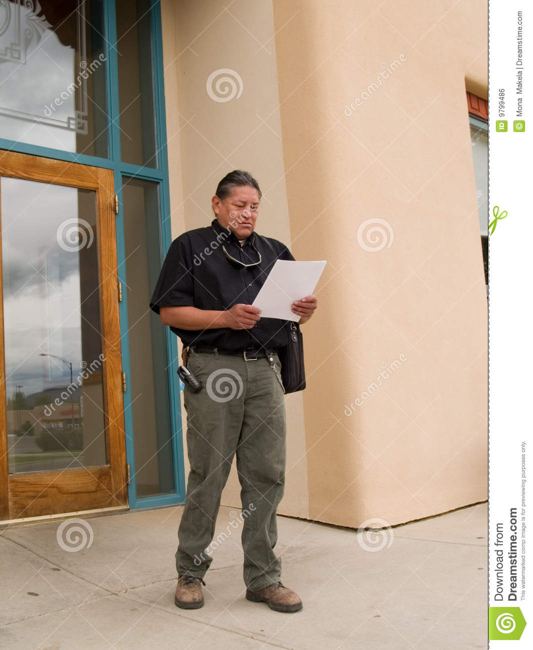 Native American man glancing at papers