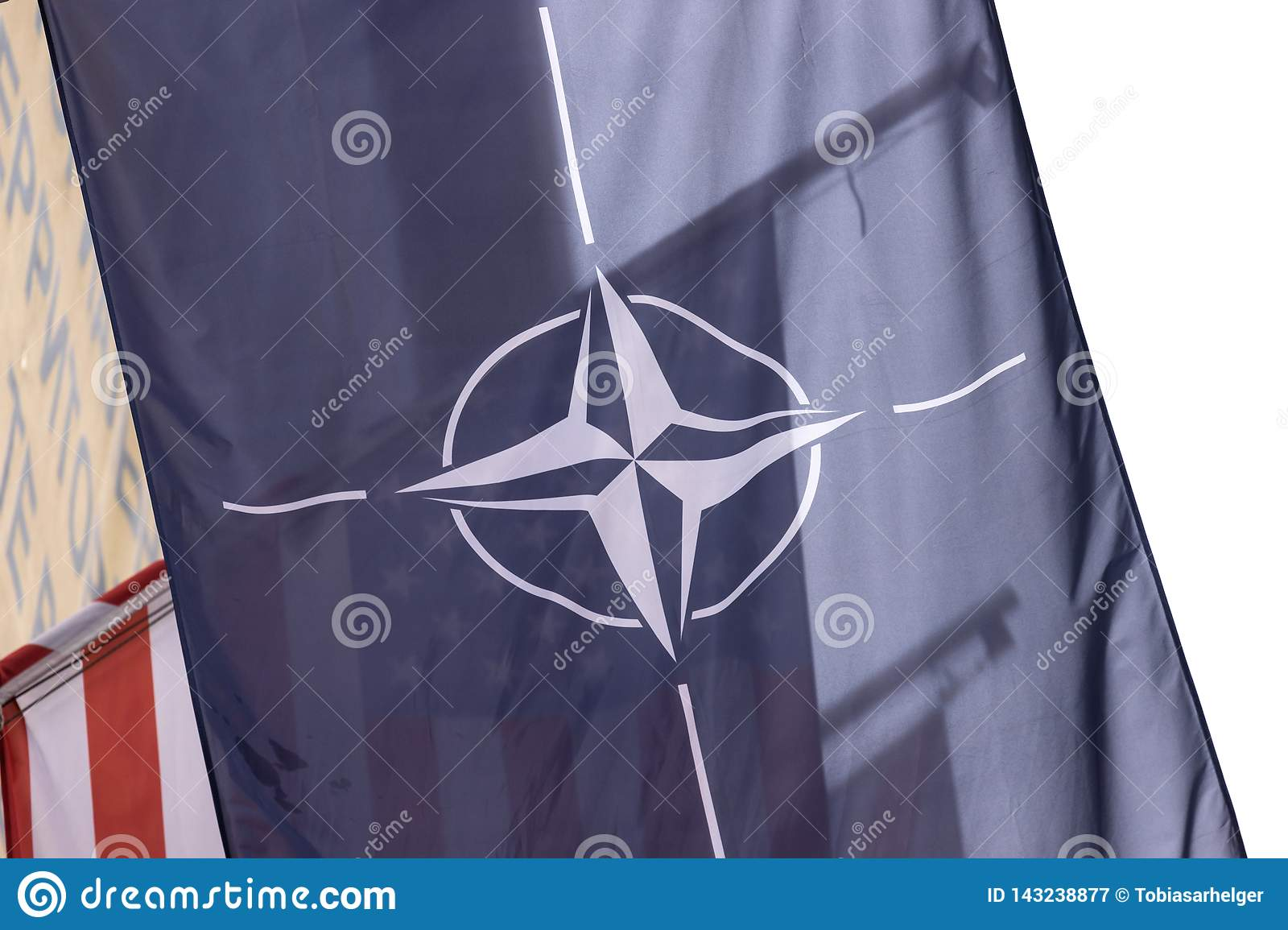 Nato flag in front of an usa flag