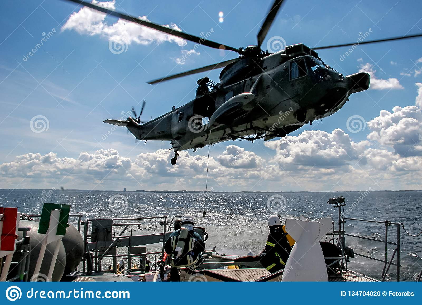 NATO rescue mission in sea with ship and helicopter