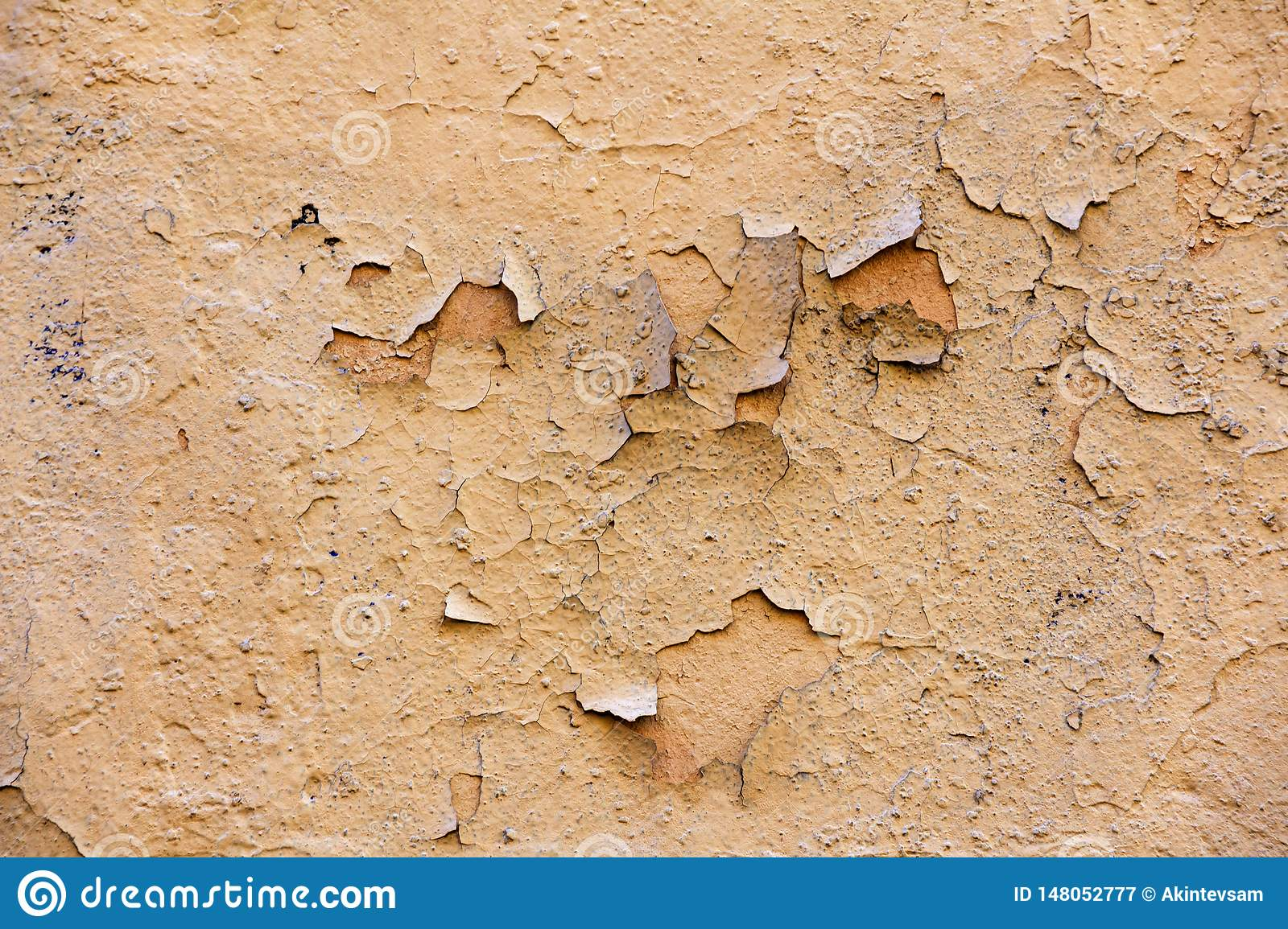 Natural wall with peeling paint.  cracks and stains of paint