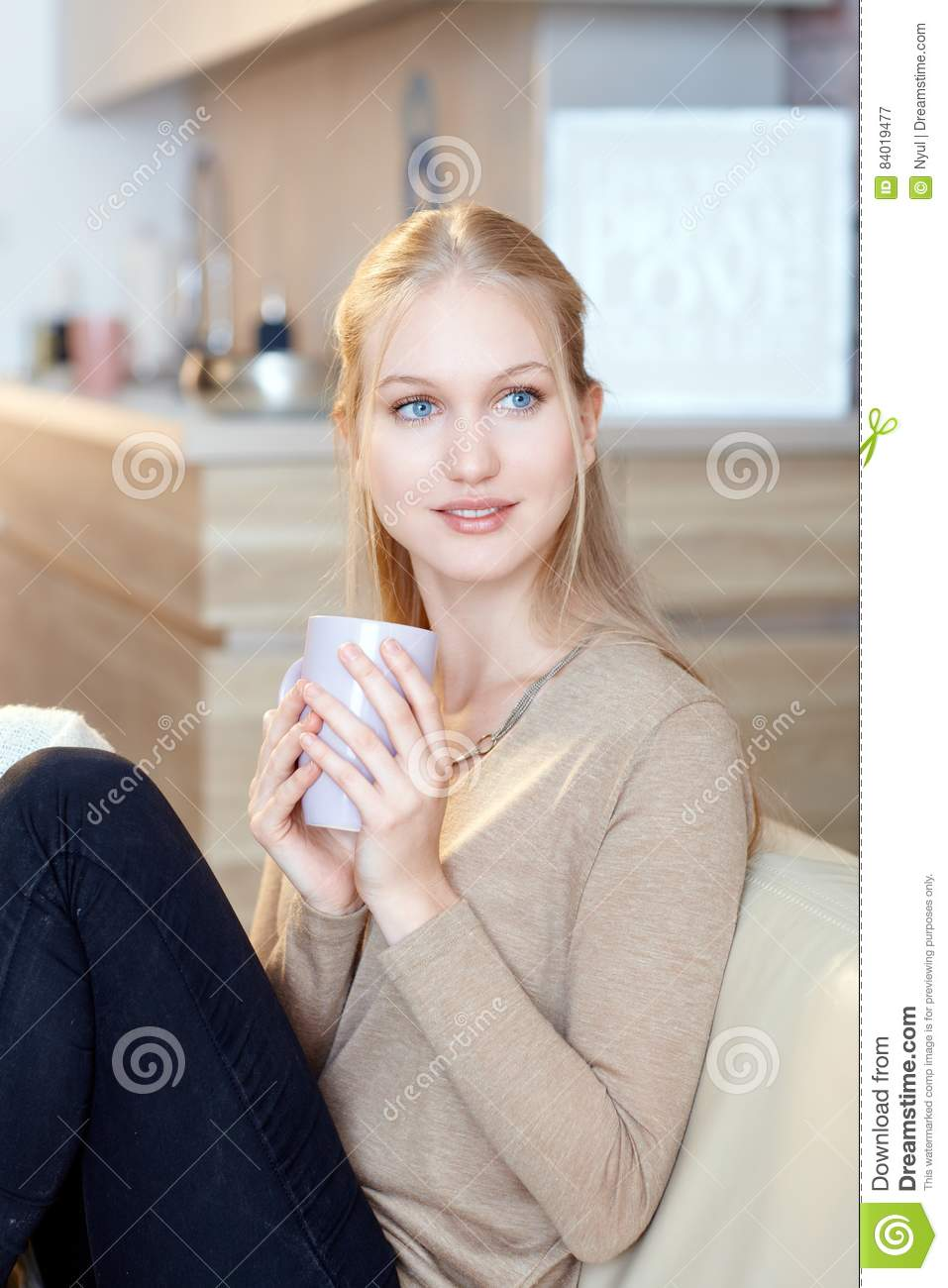 Natural beauty woman drinking tea at home