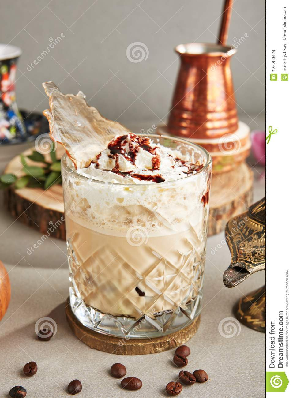 281e0f415e1 Natural Cold Coffee with Whipped Cream, Ice and Chocolate Syrup Closeup. Latte  Macchiato, Cappuccino or Mocha with Milk Foam on Dark Vintage Background ...