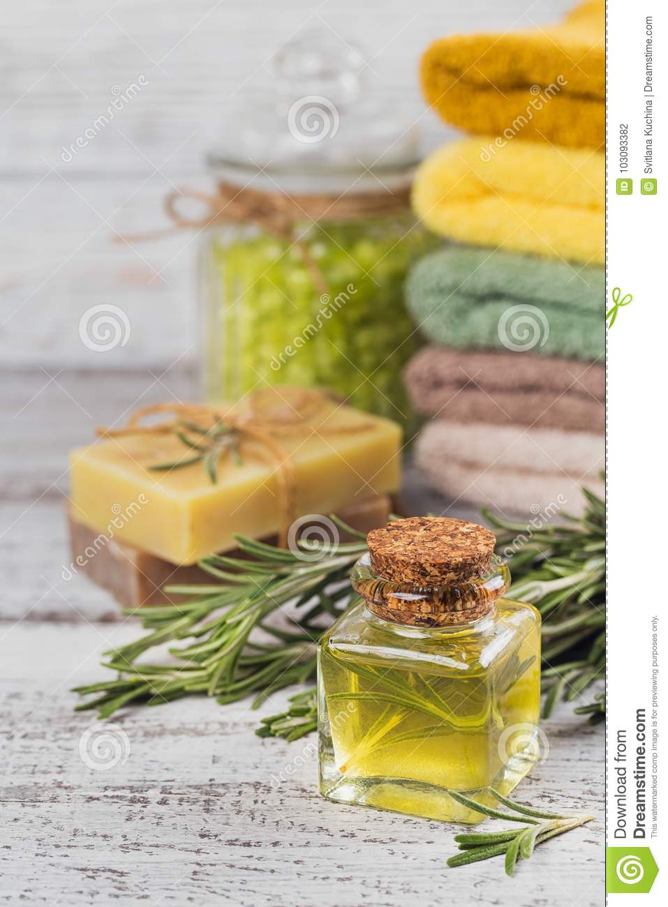 Natural cosmetic oil and natural handmade soap with rosemary on
