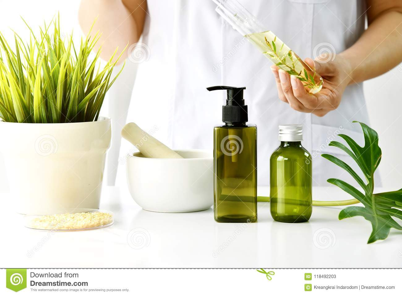 Natural cosmetic or skincare development in laboratory, Organic extract in cosmetic bottle container.
