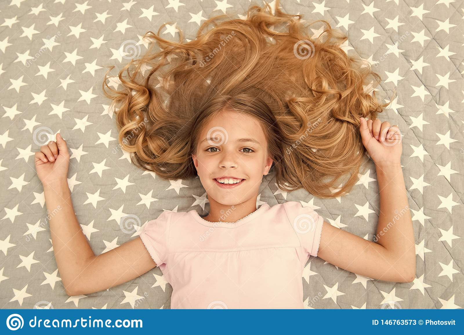 Natural Curls Treat And Care Girl Child With Long Curly Hair Lay On Bed Top View Child Perfect Curly Hairstyle Looks Stock Image Image Of Healthy Interior 146763573