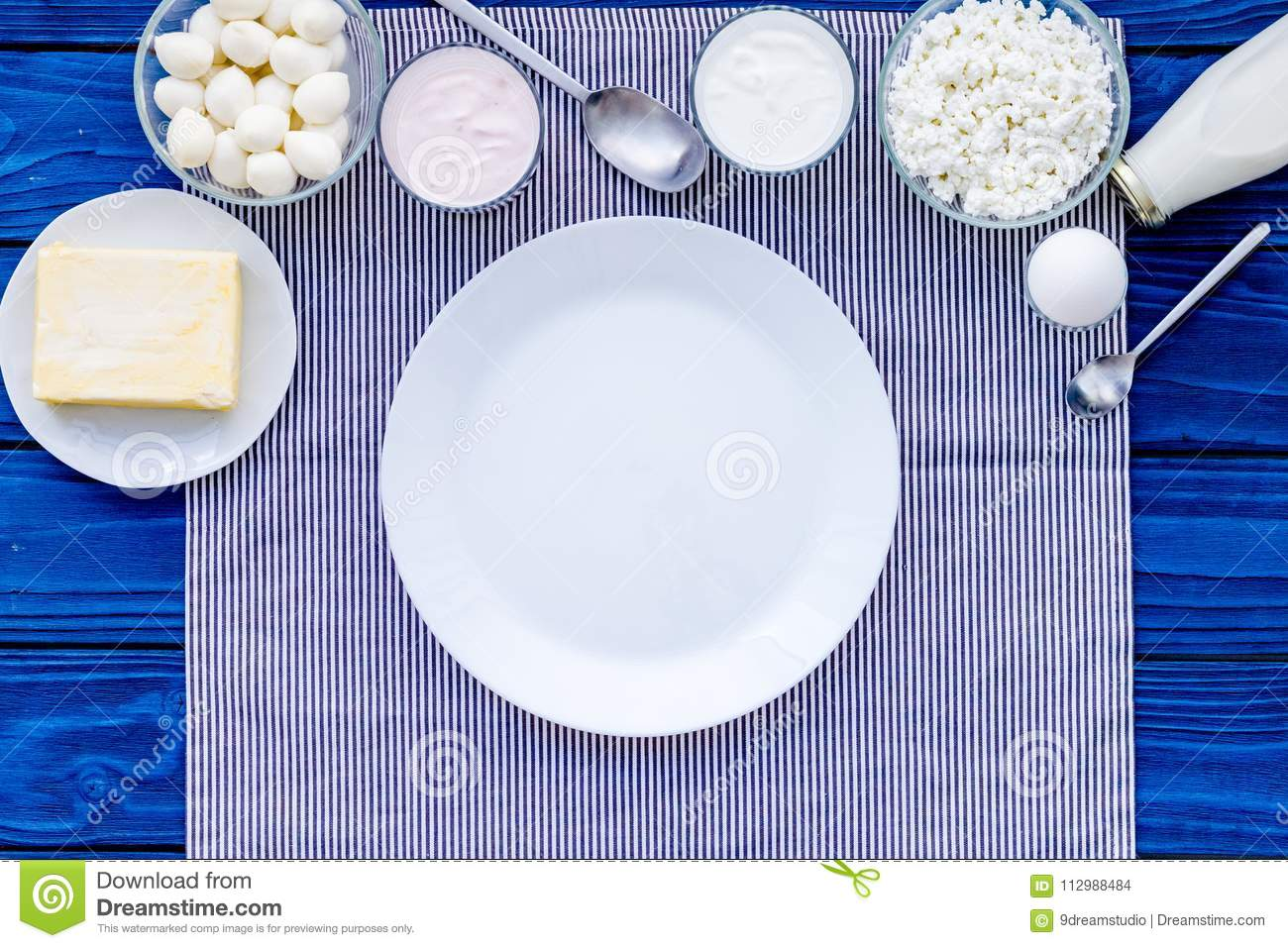 Natural farm products. Milk, cottage, eggs, cheese, yougurt on blue background top view copy space