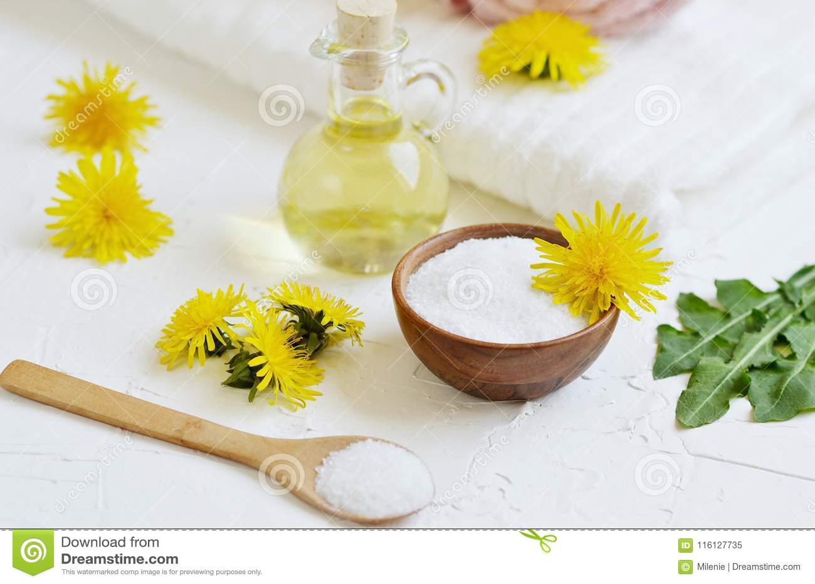 Natural ingredients for homemade body salt scrub with dandelion flowers, lemon, honey and olive oil