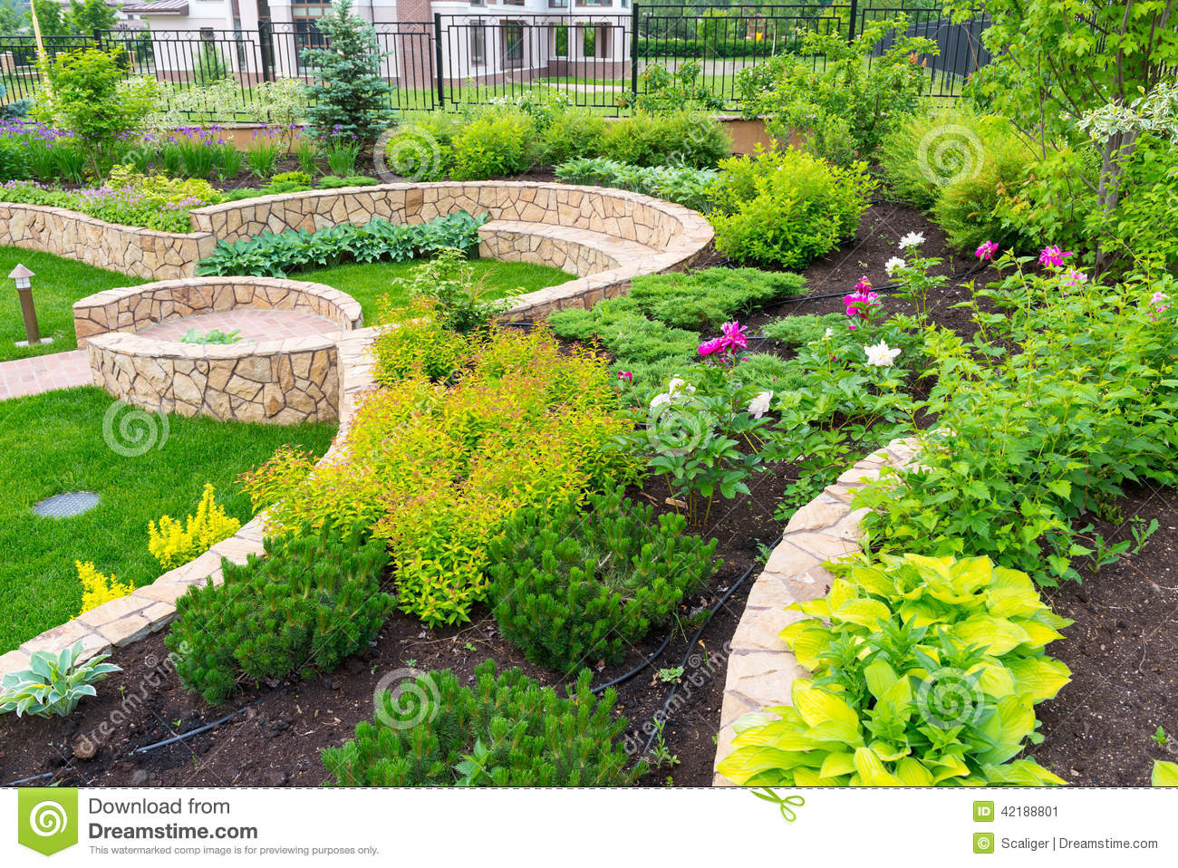 Natural landscaping in home garden stock image image for Garden landscape photos