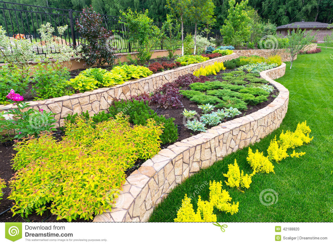 Natural landscaping in home garden stock photo image of for Garden landscape photos