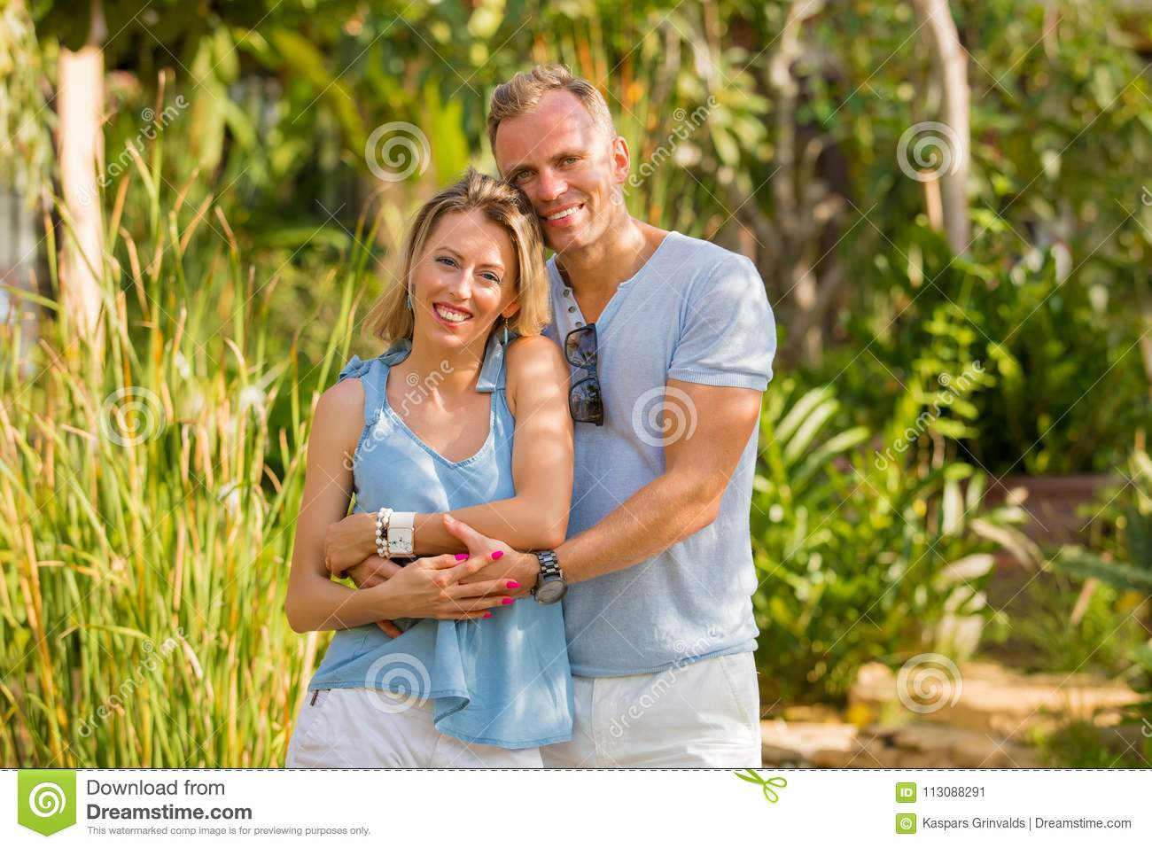 Natural looking happy couple embraced