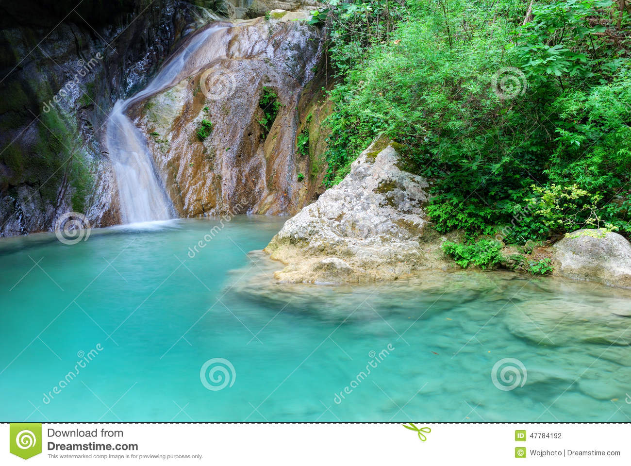 Natural pool with azure water and a small waterfall stock - Crystal clear pools ...