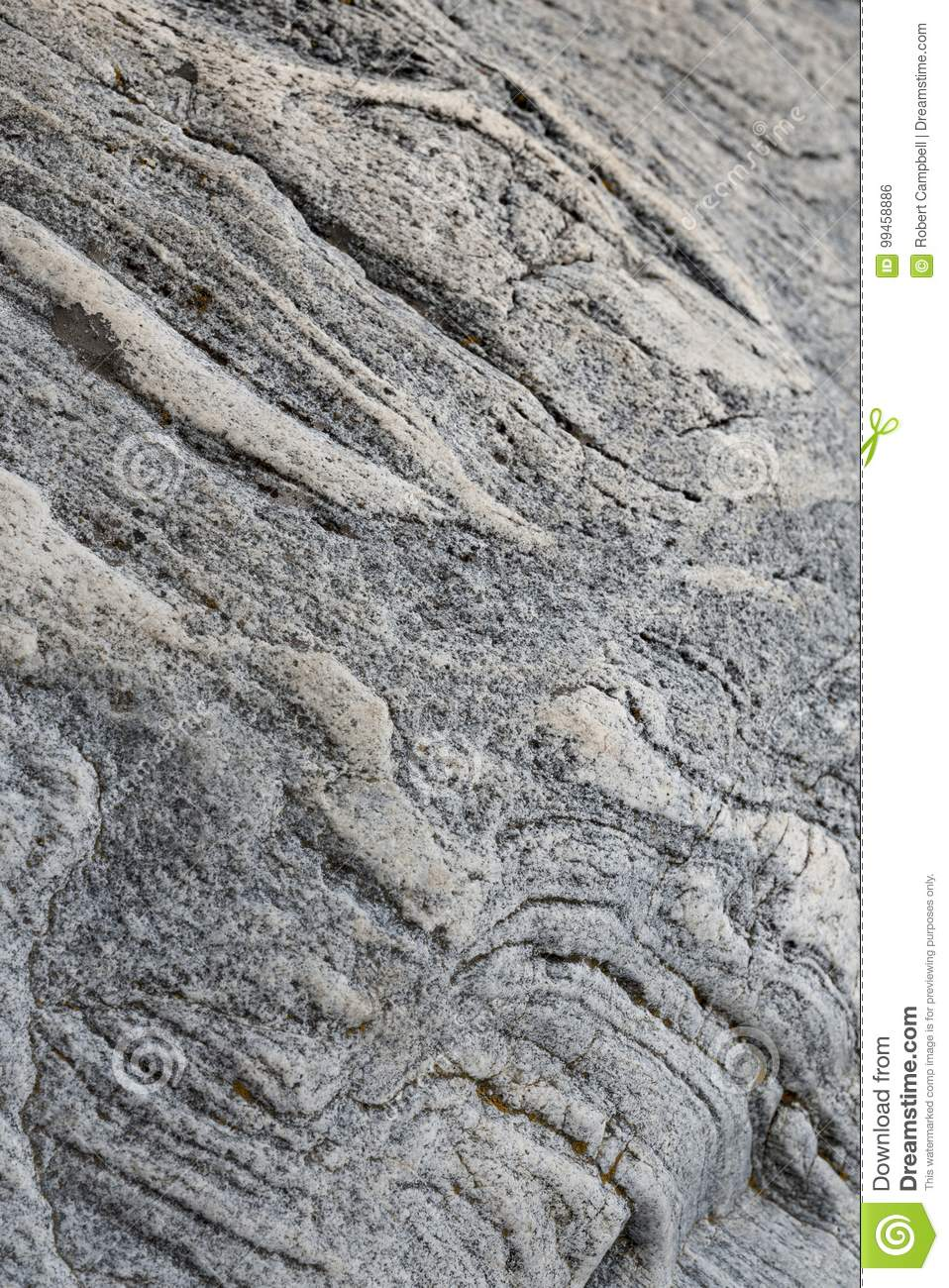 Rough Granite Stone : Natural rough granite stone showing wavy stratification