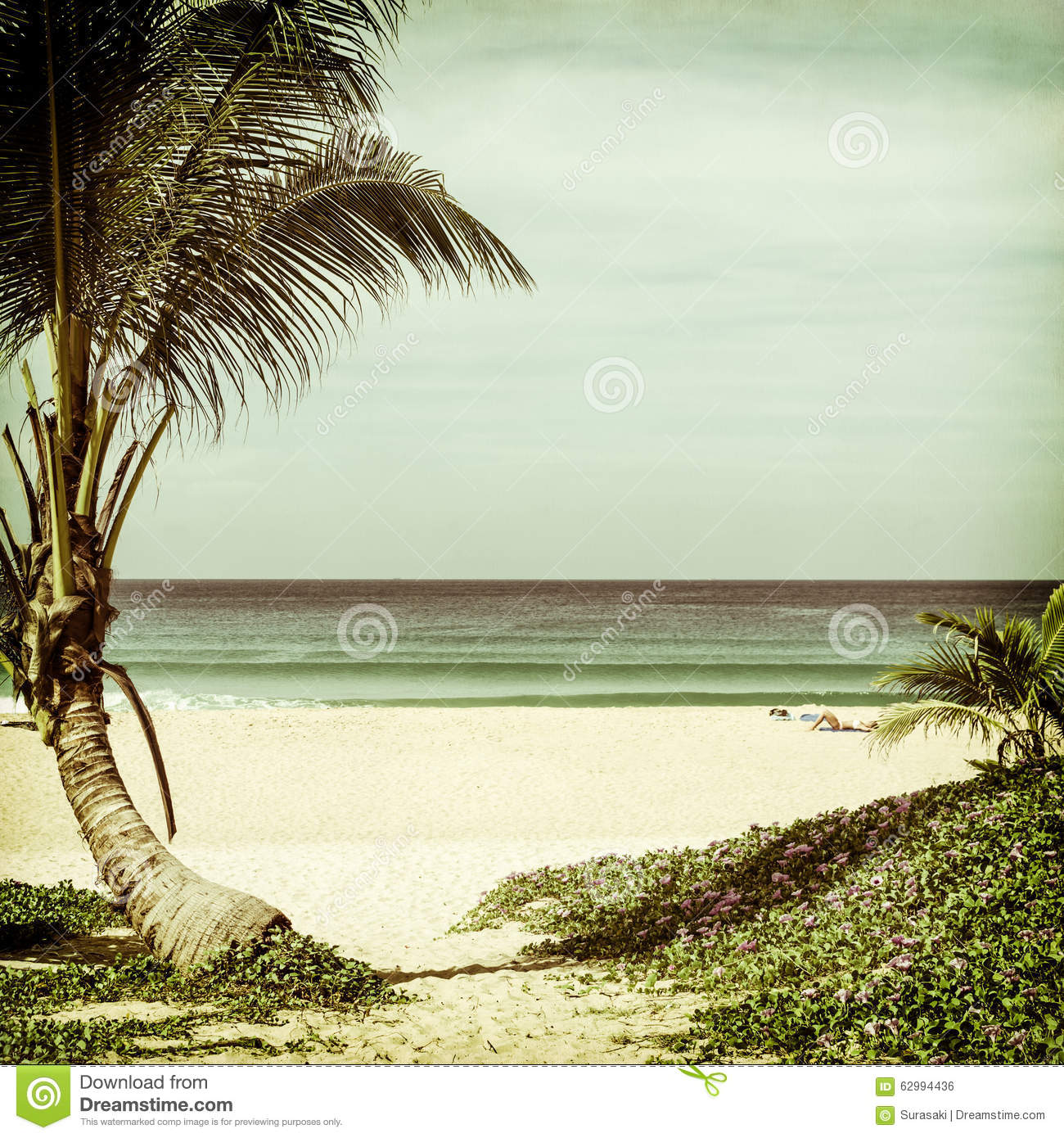 Natural Seascape With A Woman Relaxing On The Beach Stock