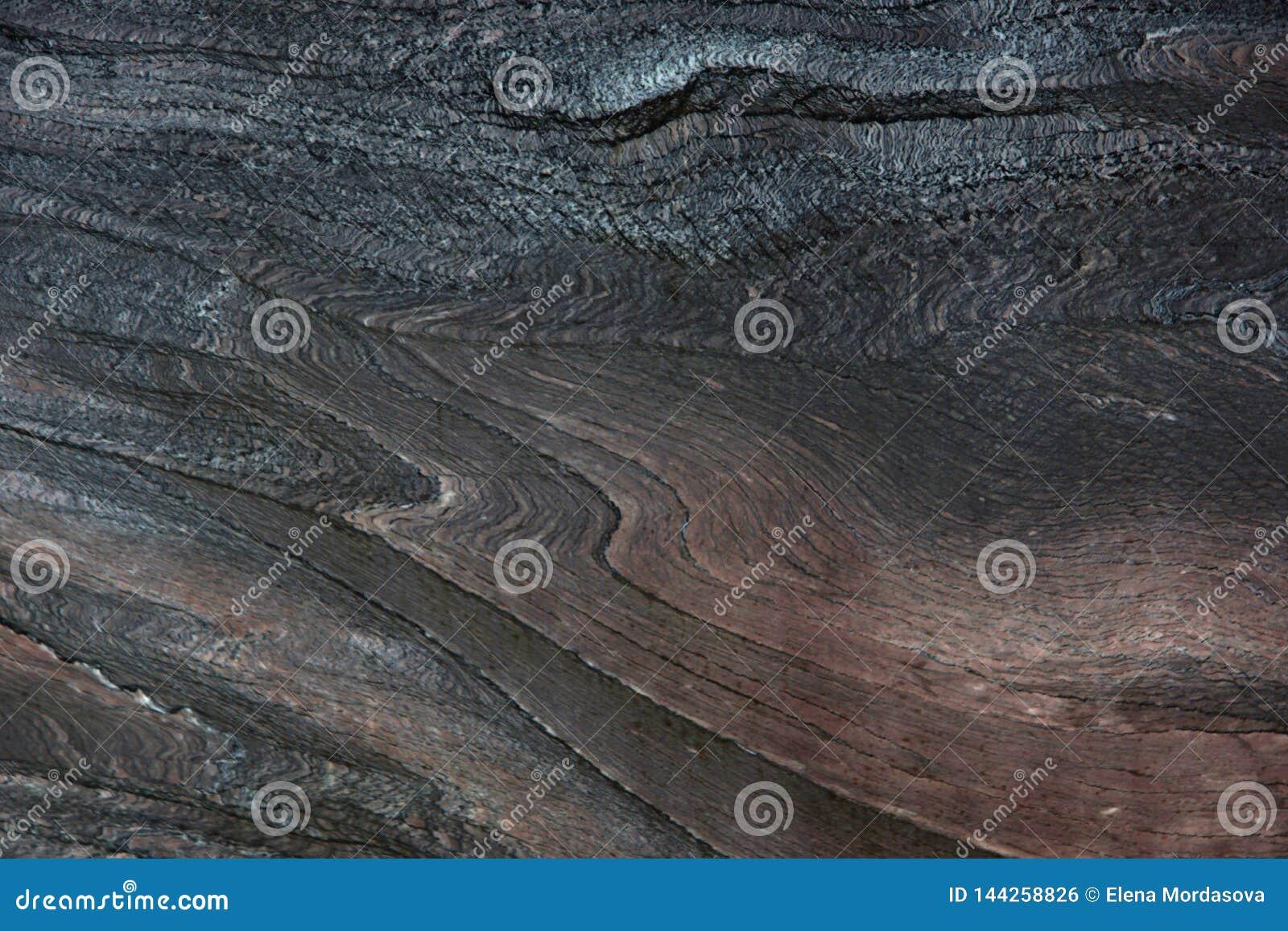 Natural stone dark quartzite with beautiful patterns, called Rosso Luana