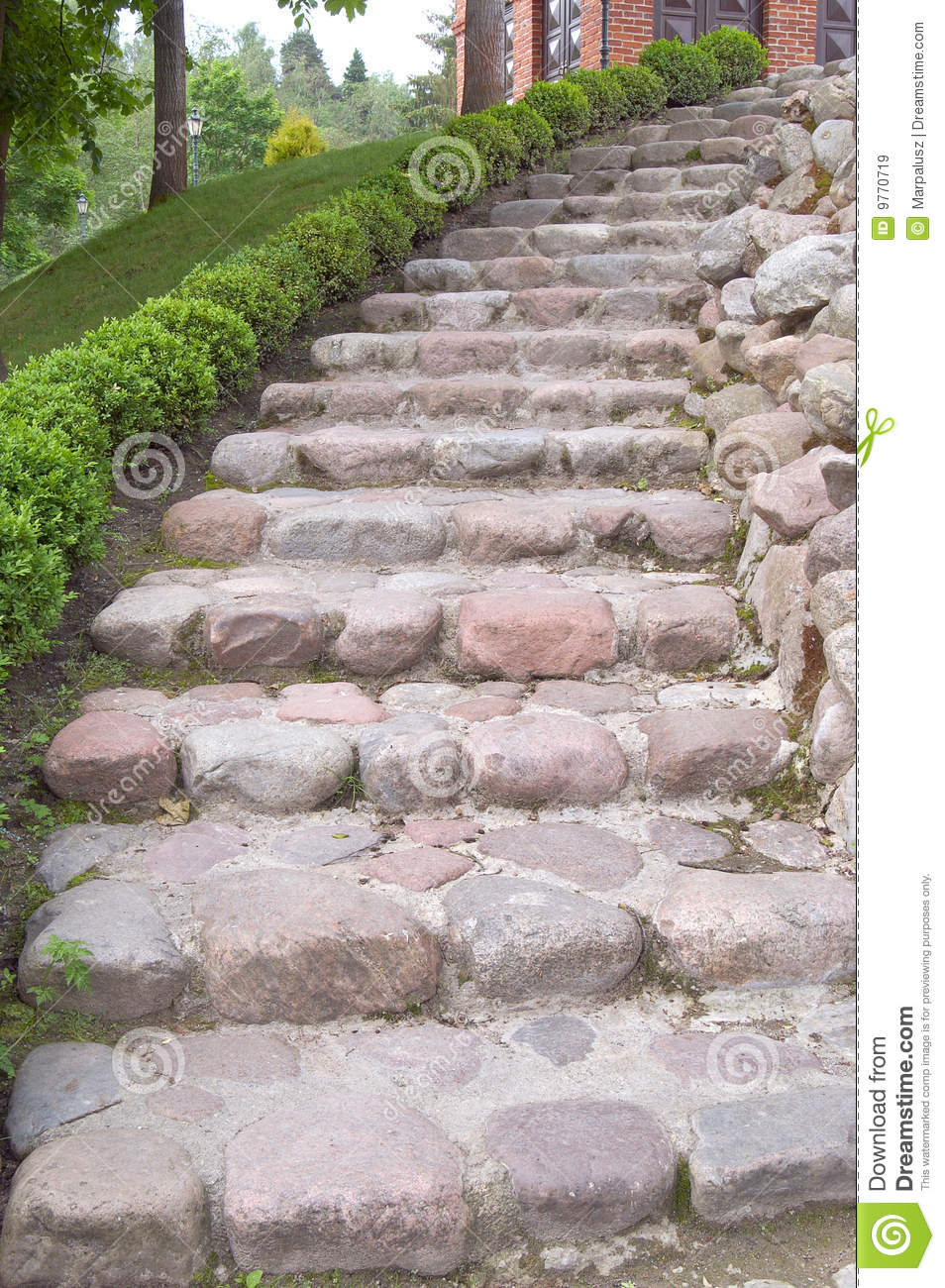 Natural Stone Stairs : Natural stone steps along a flowerbed stock image