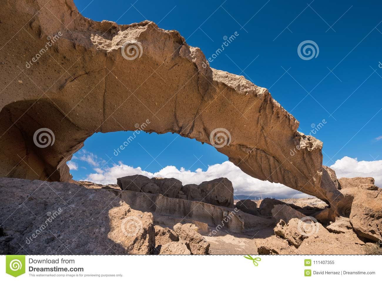 Natural volcanic rock arch formation in desertic landscape in Tenerife, Canary islands, Spain.