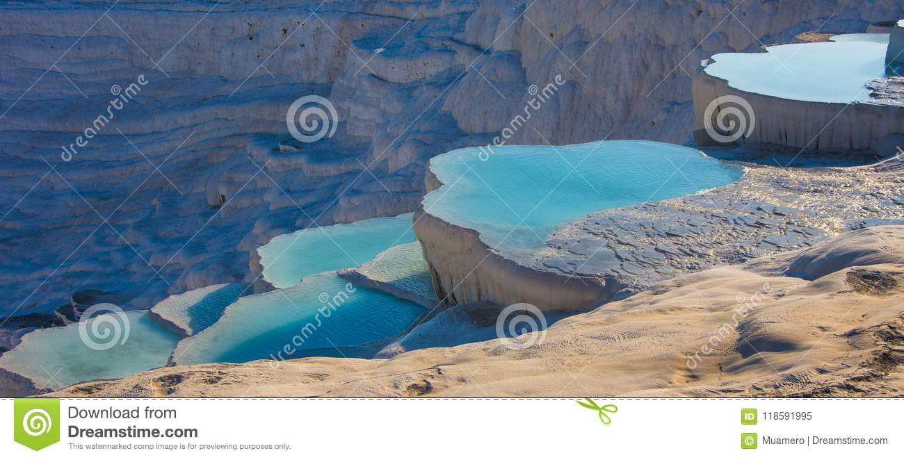 The natural white stone swimming pools fill with the thermal water