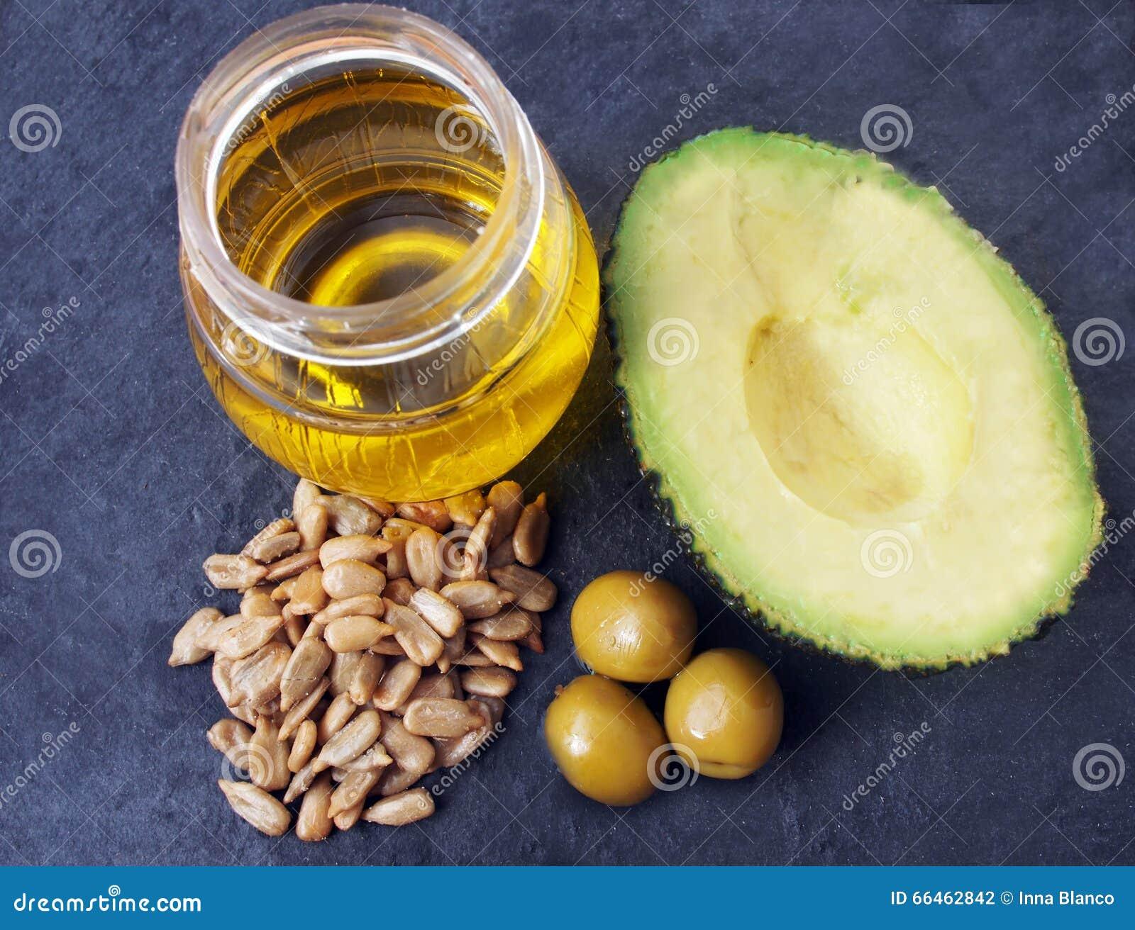 Naturalny źródło witamina E - słonecznikowi ziarna, oliwki, avocado, jarzynowy olej