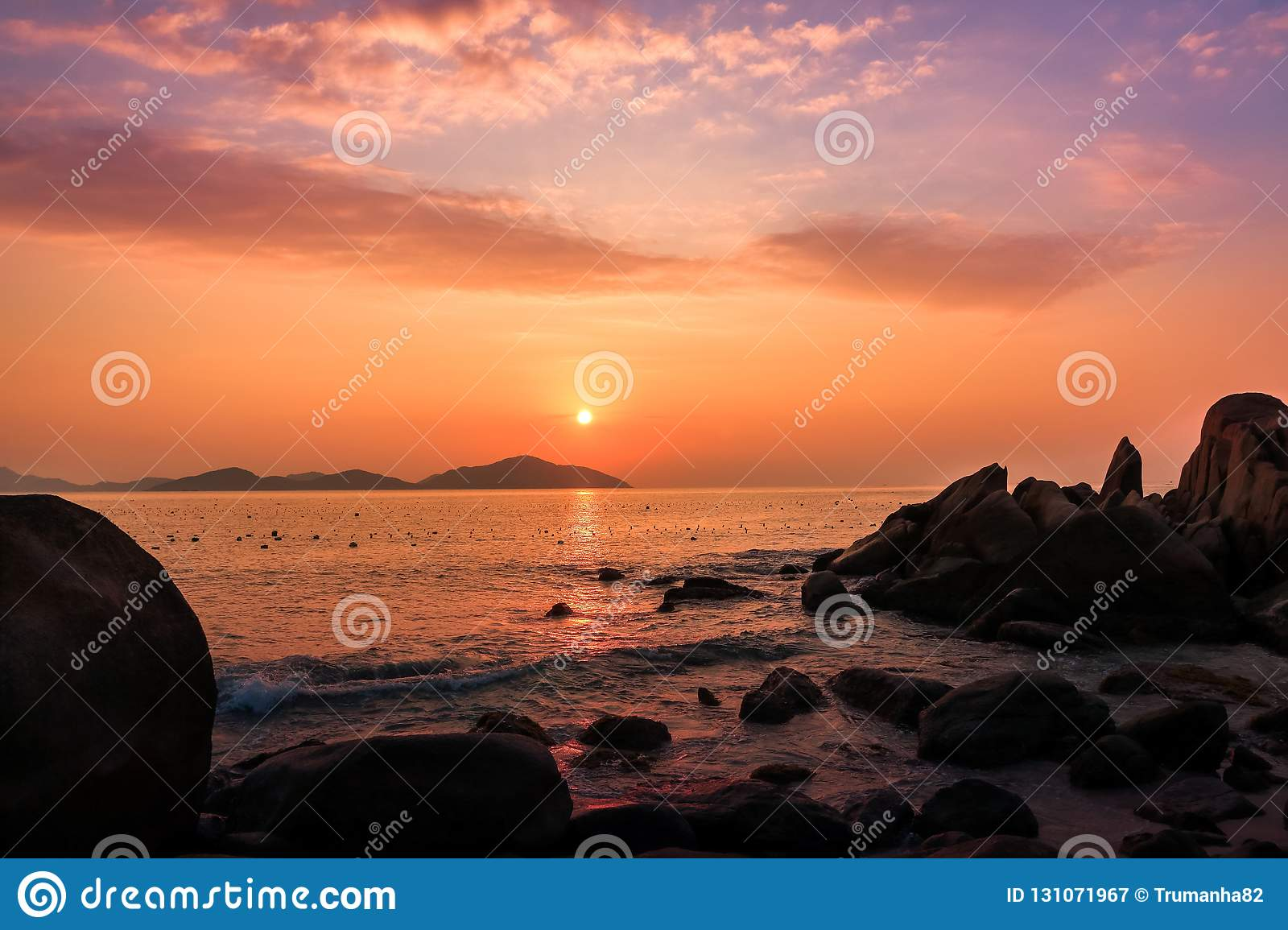 Nature Seascape with Boulders, Islands and Waves at Gorgeous Orange Sunrise