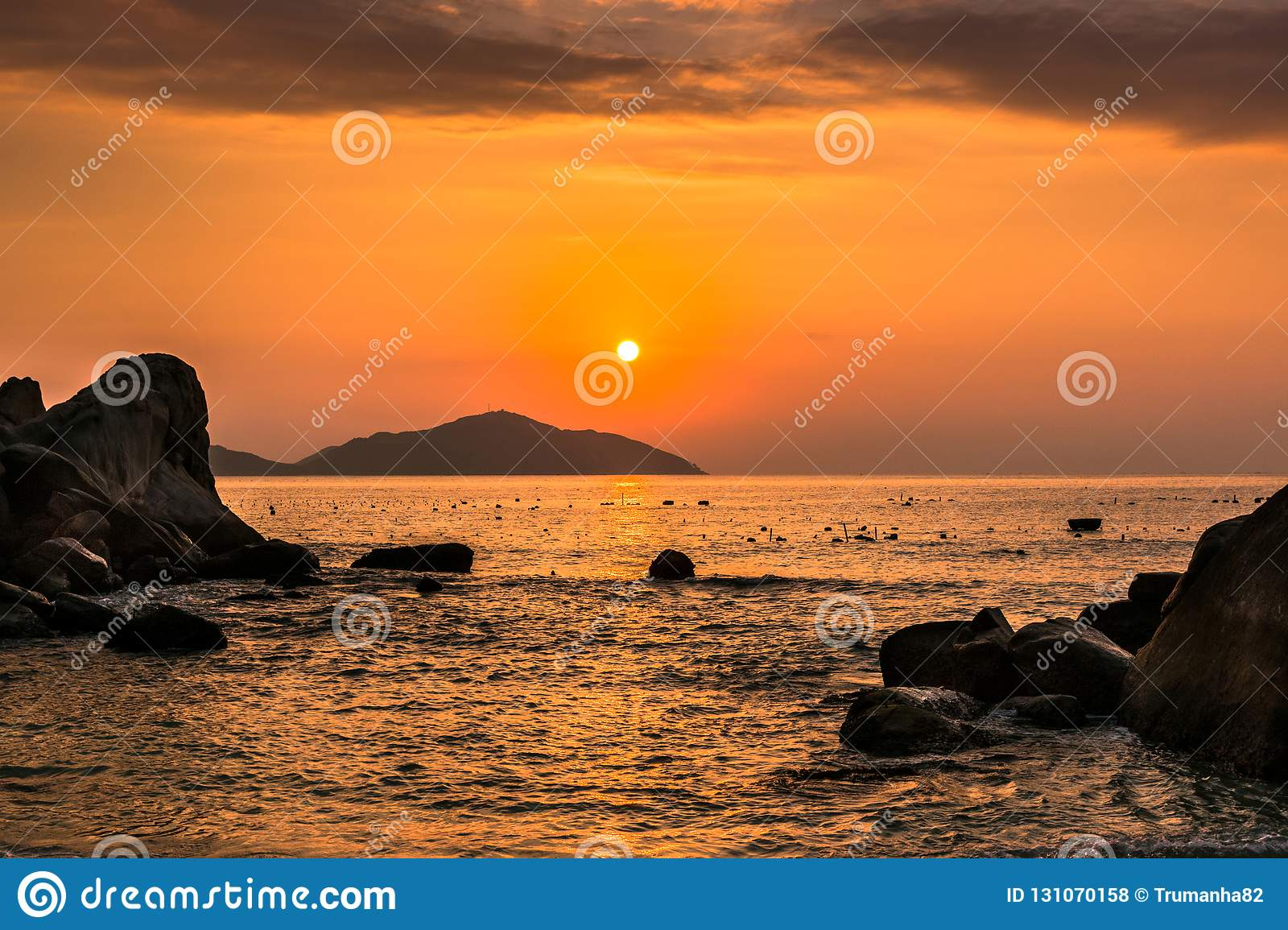 Nature Seascape with Boulders, Islands and Waves at Orange Sunrise