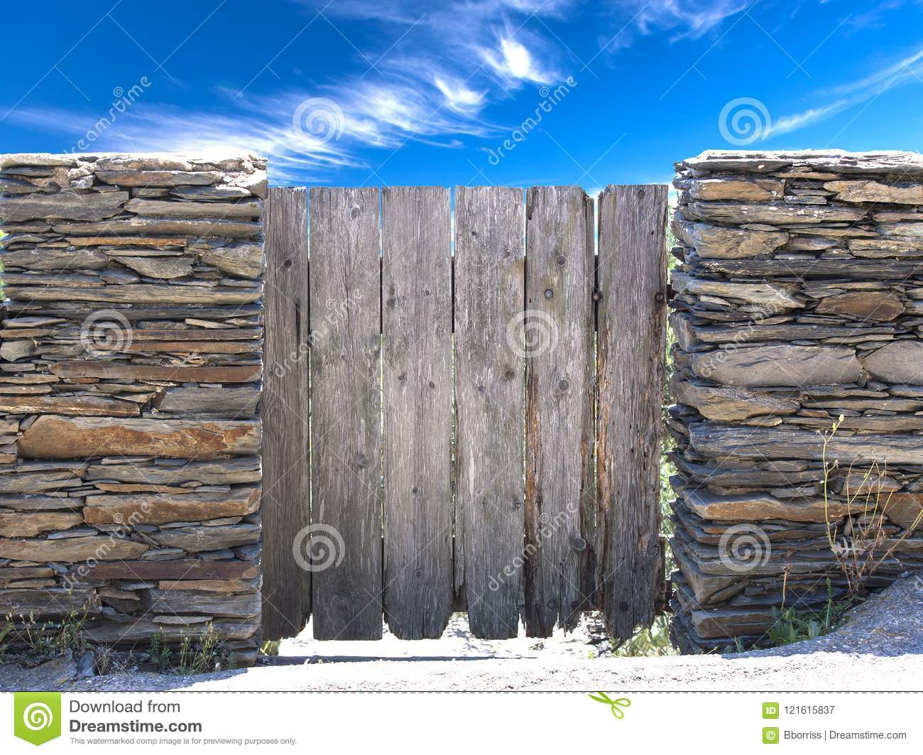 Nature summer landscape. Countryside view and rustic gate in drystone wall in village Cadaces