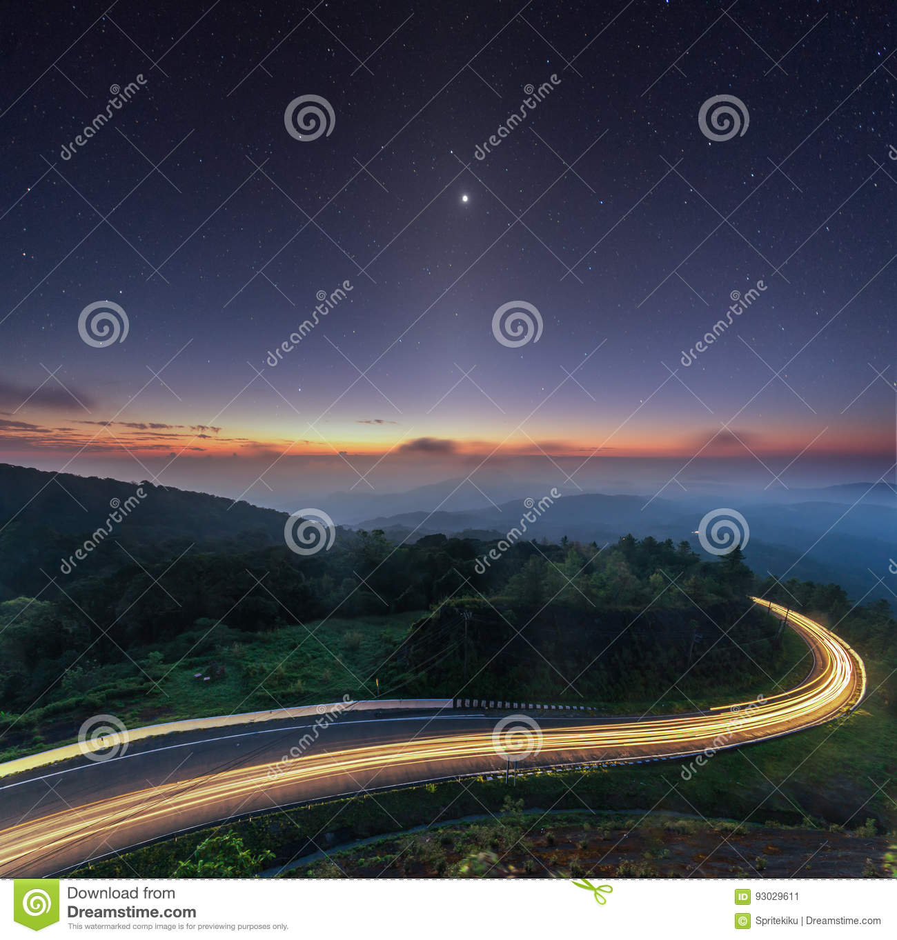Nature sunrise background amazing curve road and zodiacal light star night sky twilight color long exposure . Popular travel