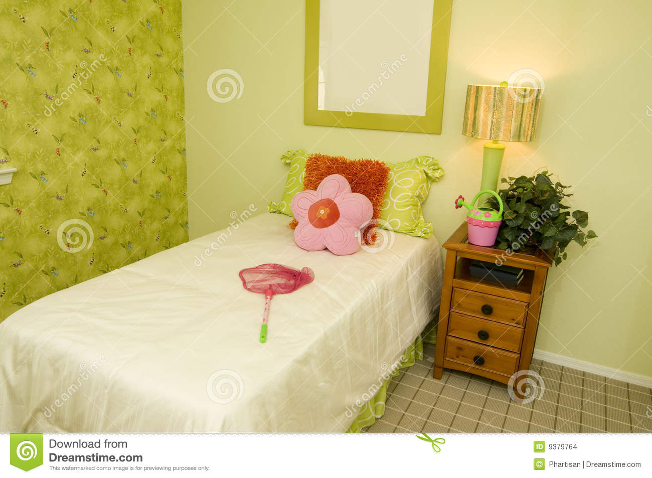 Nature themed young child's bedroom with net on bed.