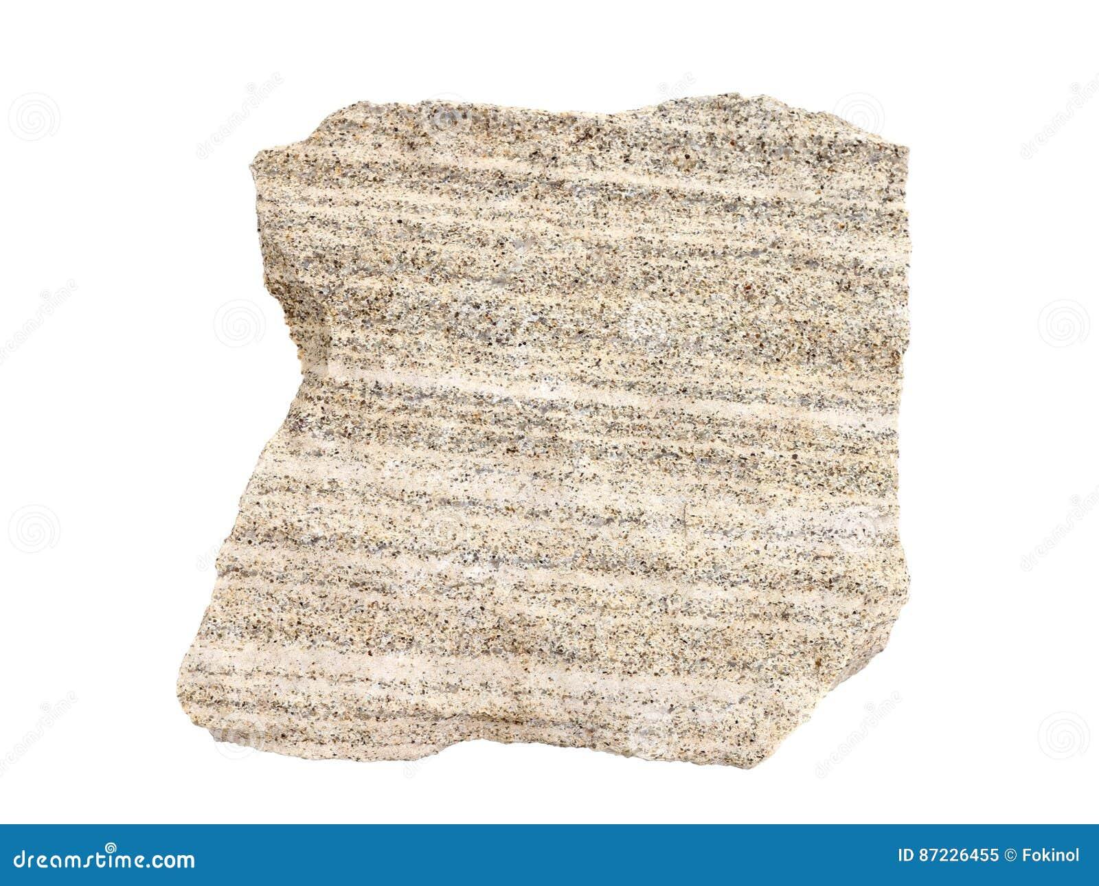 Natuurlijke steekproef van gelaagd zandig kalksteen - een gemeenschappelijk afzettingsgesteente op witte achtergrond