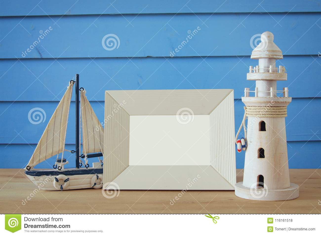 Nautical concept with sea life style objects on wooden table. For photography montage.