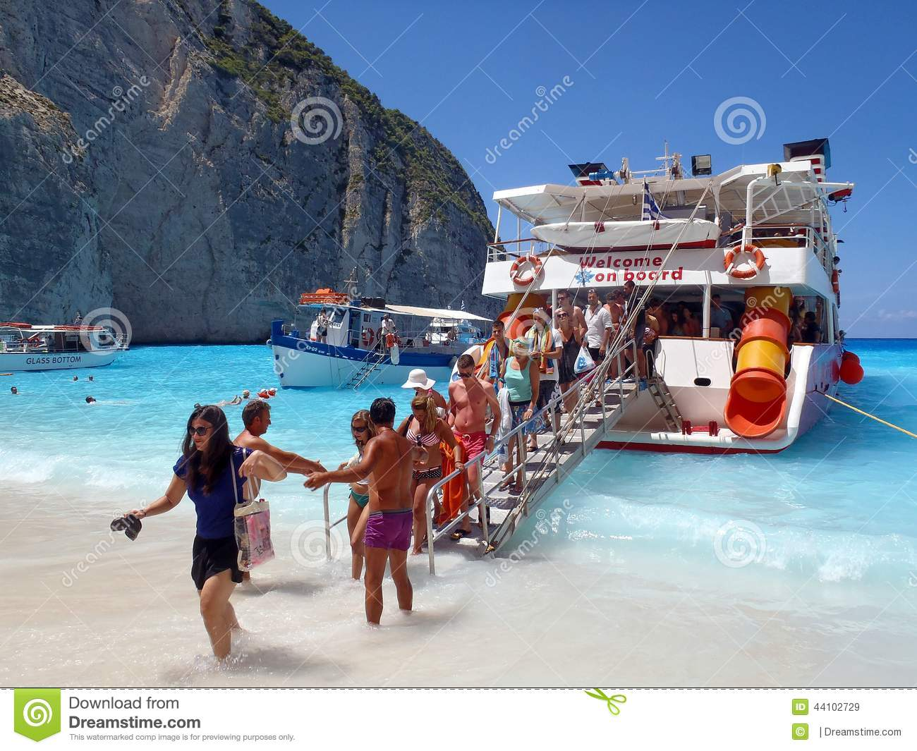 ... , Beach on Zakynthos is reached by boat. Tourists exiting cruise boat