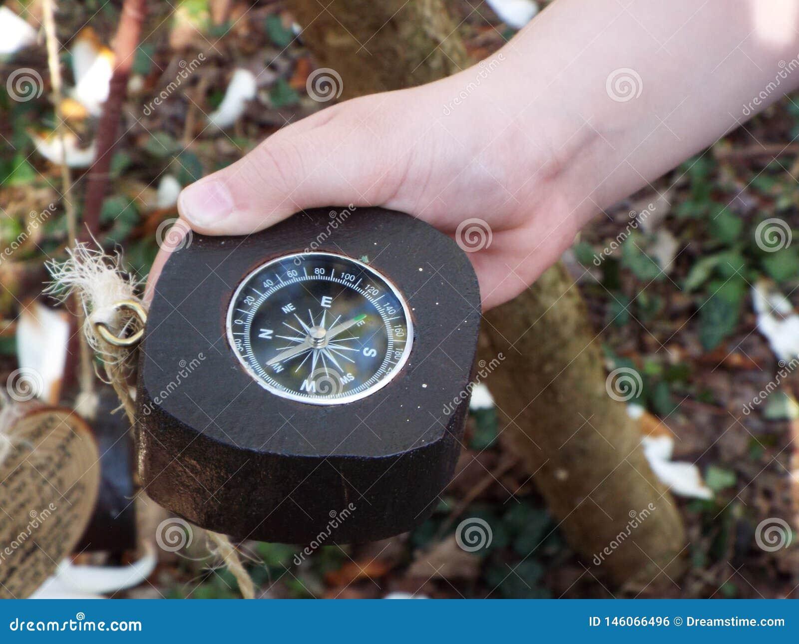 Navigational compass held in hand