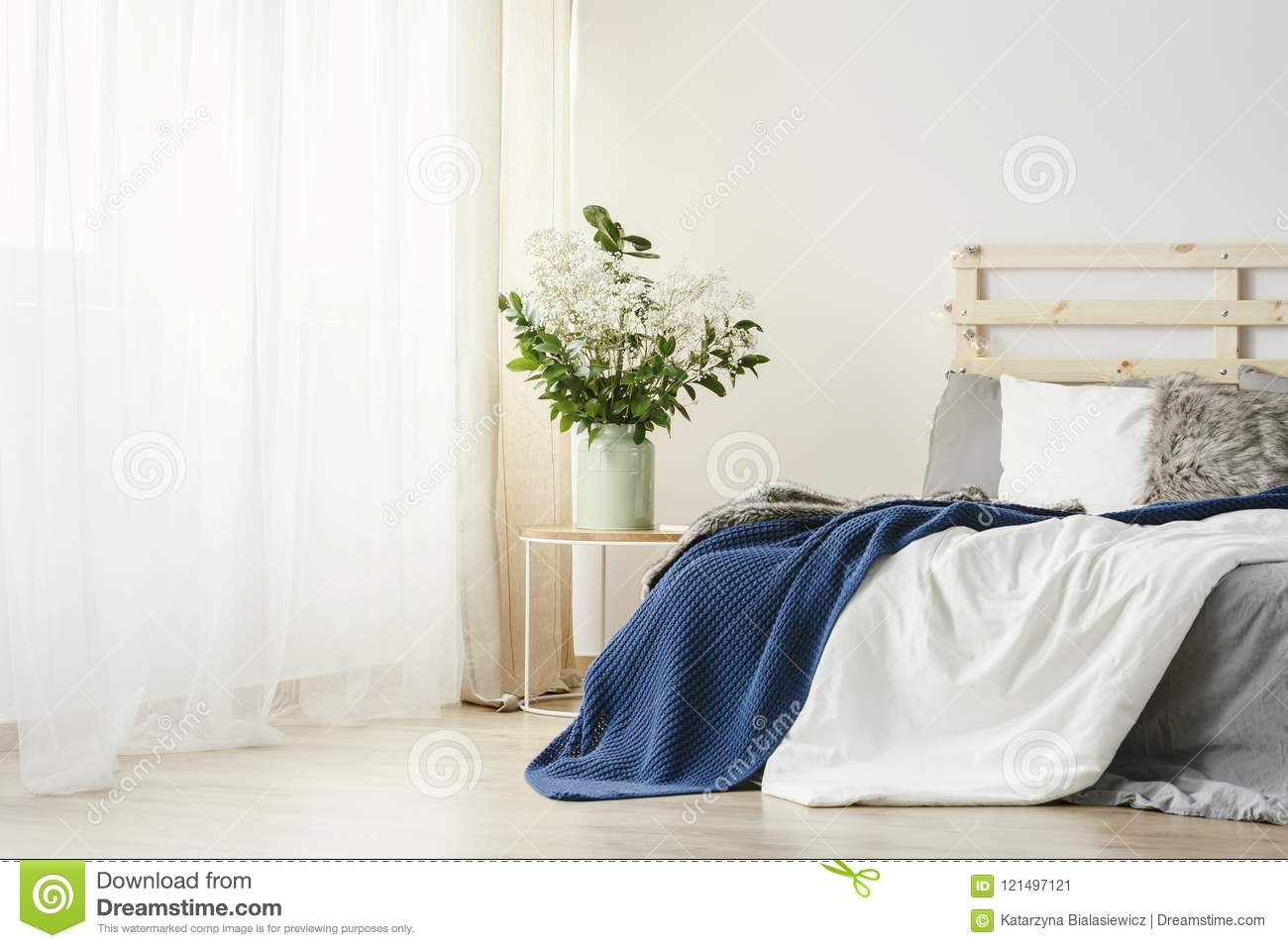 Navy Blue Blanket Thrown On Double Bed With Lights On Bedhead St Stock Image Image Of Blanket Home 121497121