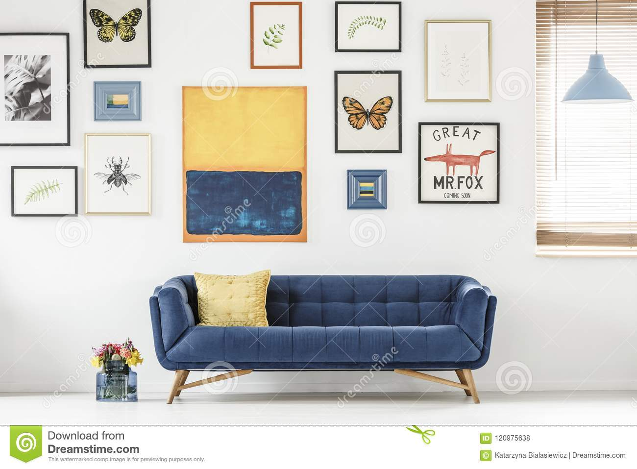 Phenomenal Navy Blue Sofa Against White Wall With Posters And Painting Theyellowbook Wood Chair Design Ideas Theyellowbookinfo