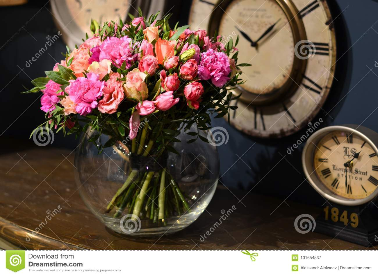 bouquet of roses in a transparent round glass vase standing on a