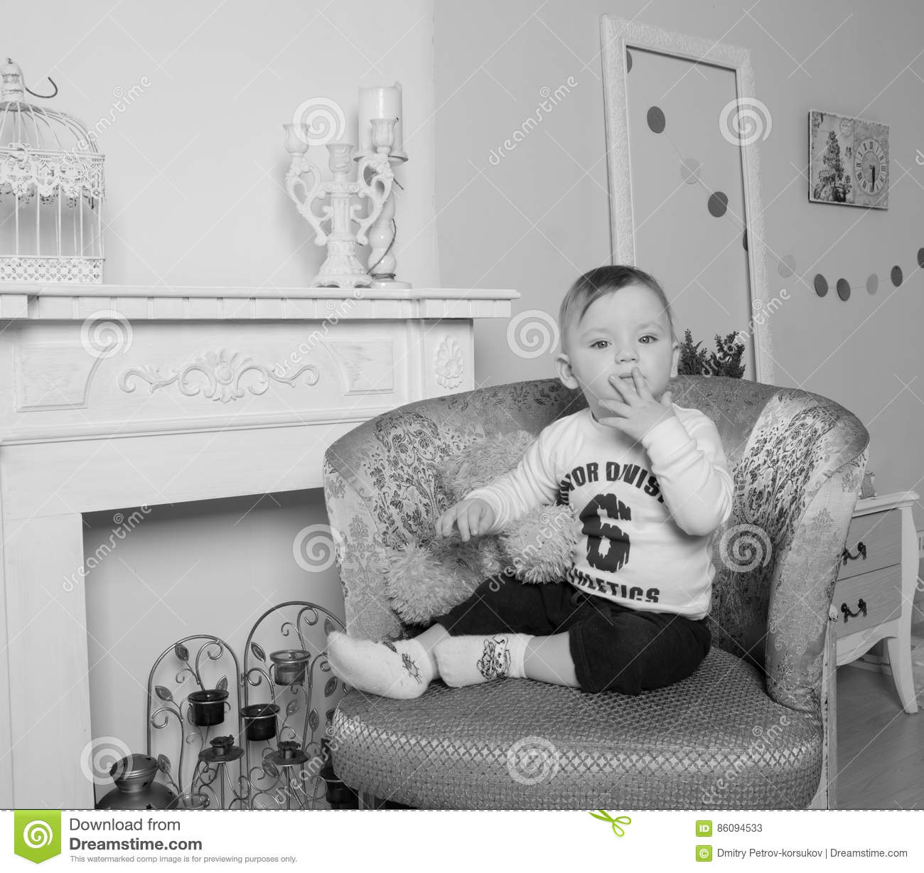 Black Child Sitting In Chair - Near the fireplace in the living room child on chair black and white