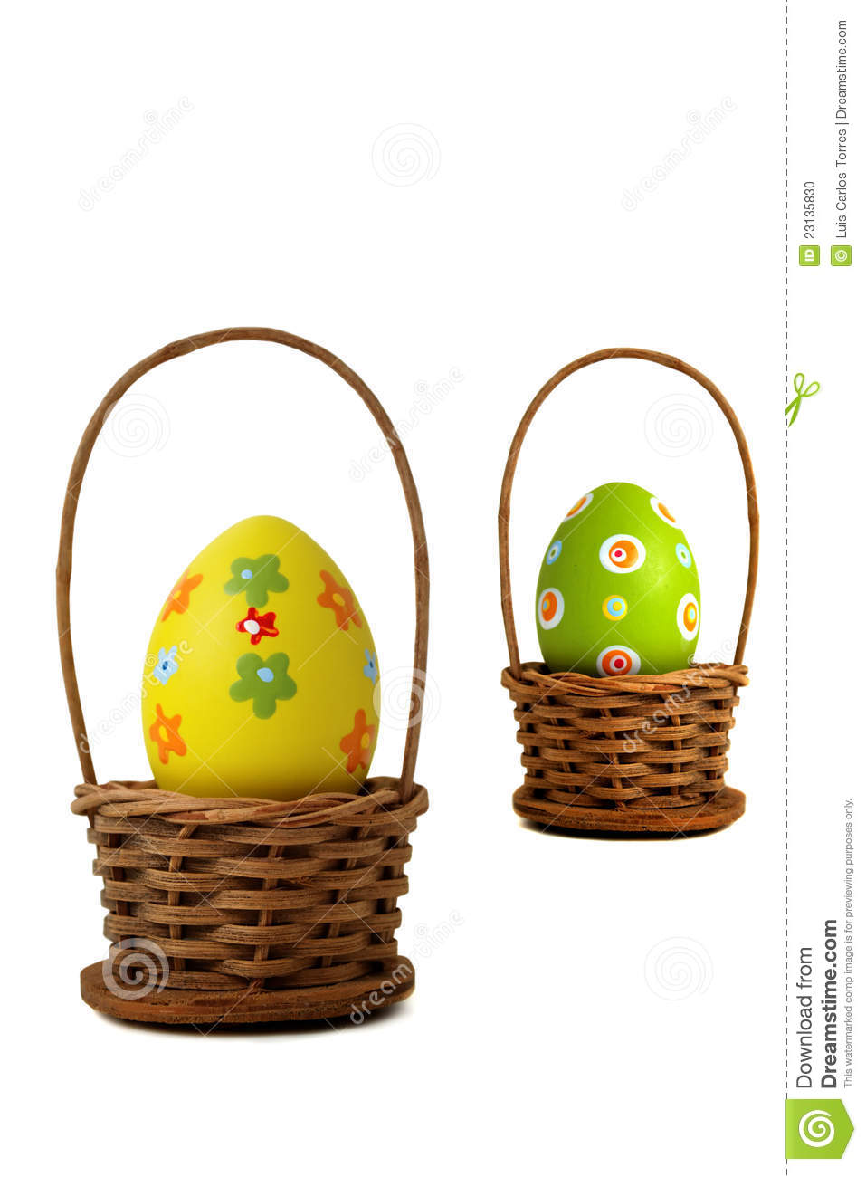 Near yellow Easter egg into a basket