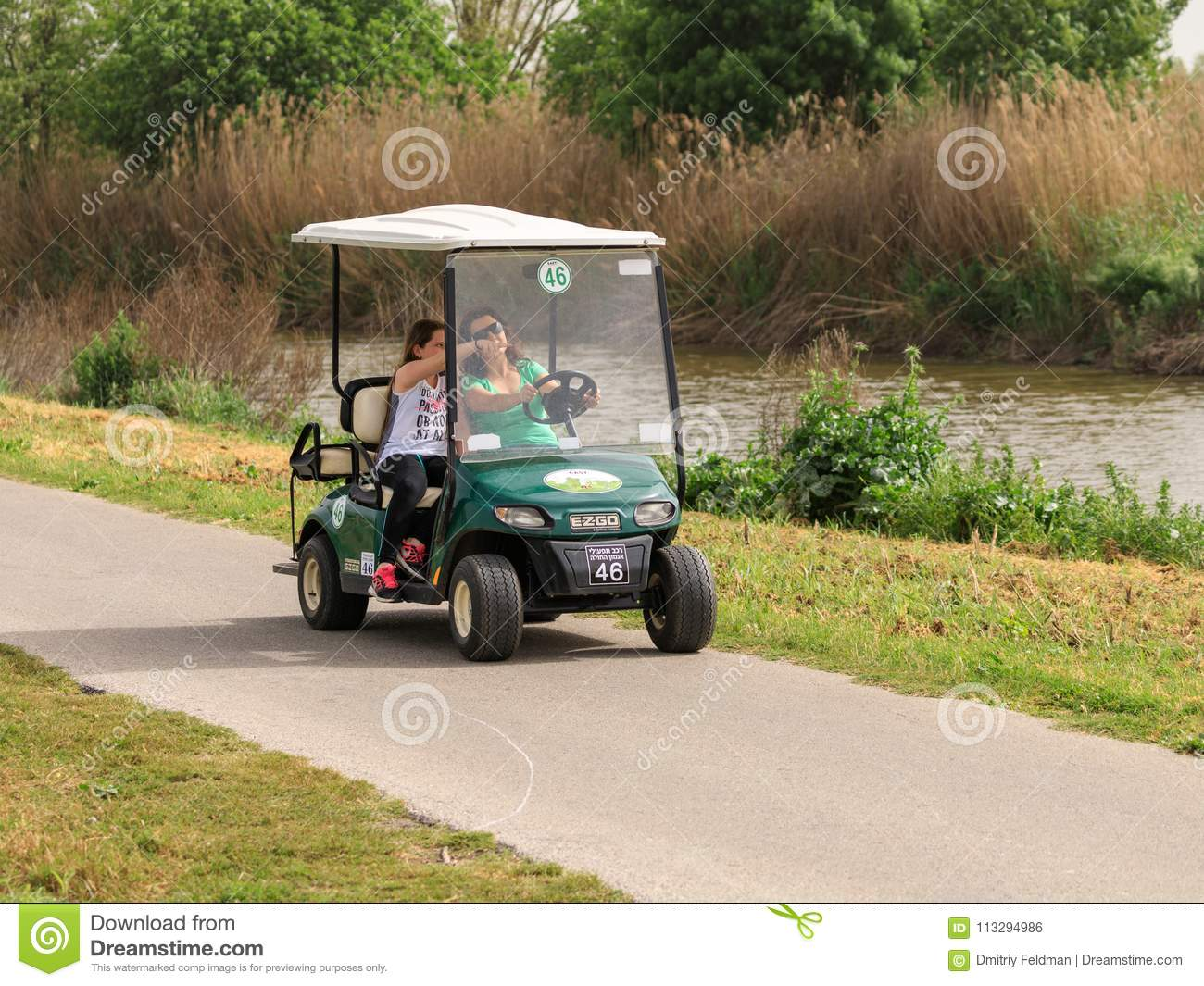 Visitors Drive Along An Electric Vehicle Path In The Hula Lake