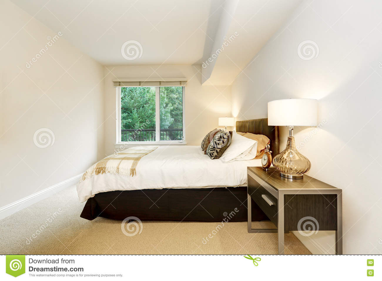 Neat Bedroom Neat Bedroom With A Bed And Nightstands With Lamps Stock Photo