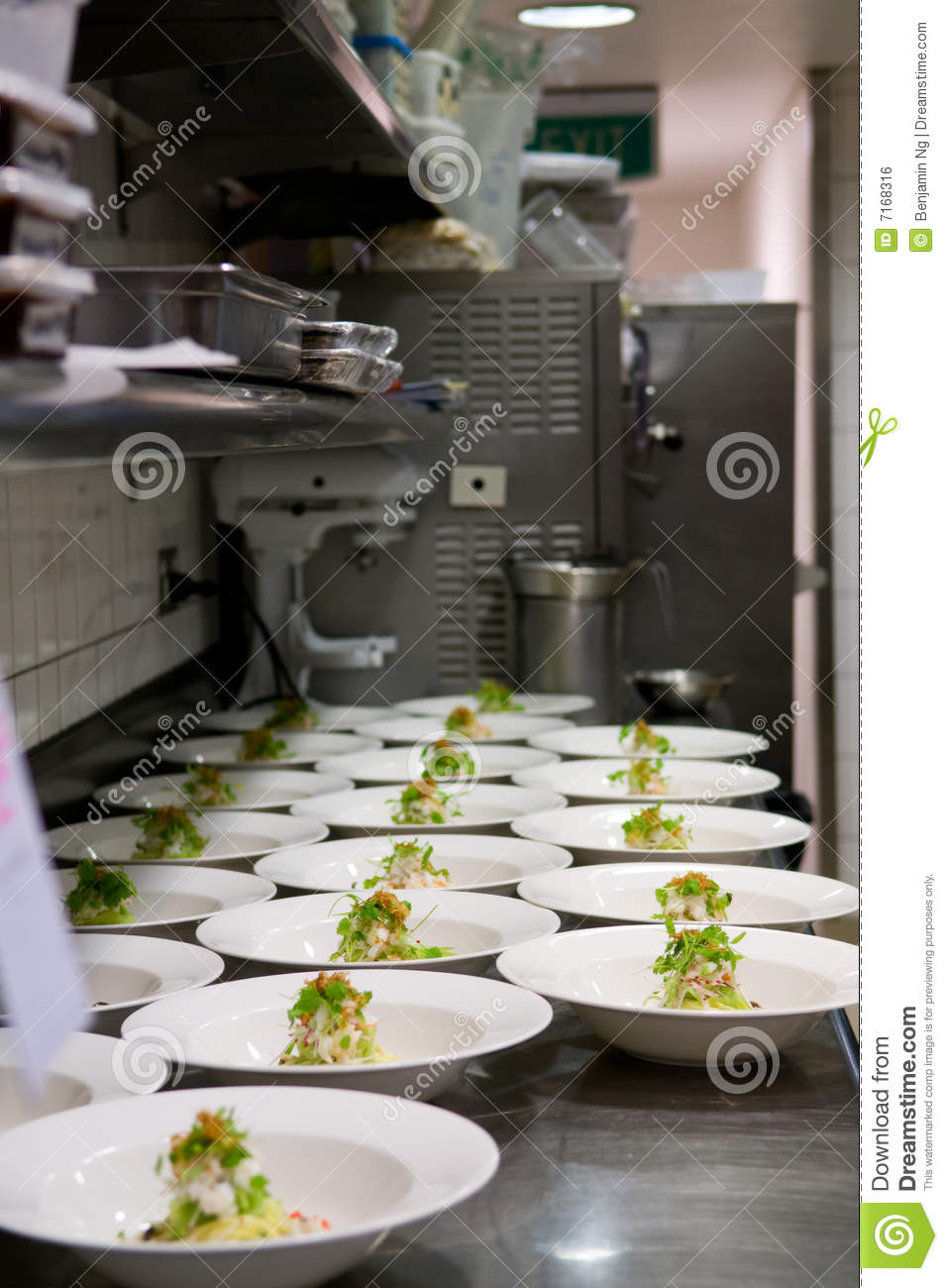 busy kitchen. Neat Rows Of Prepared Food In A Busy Kitchen