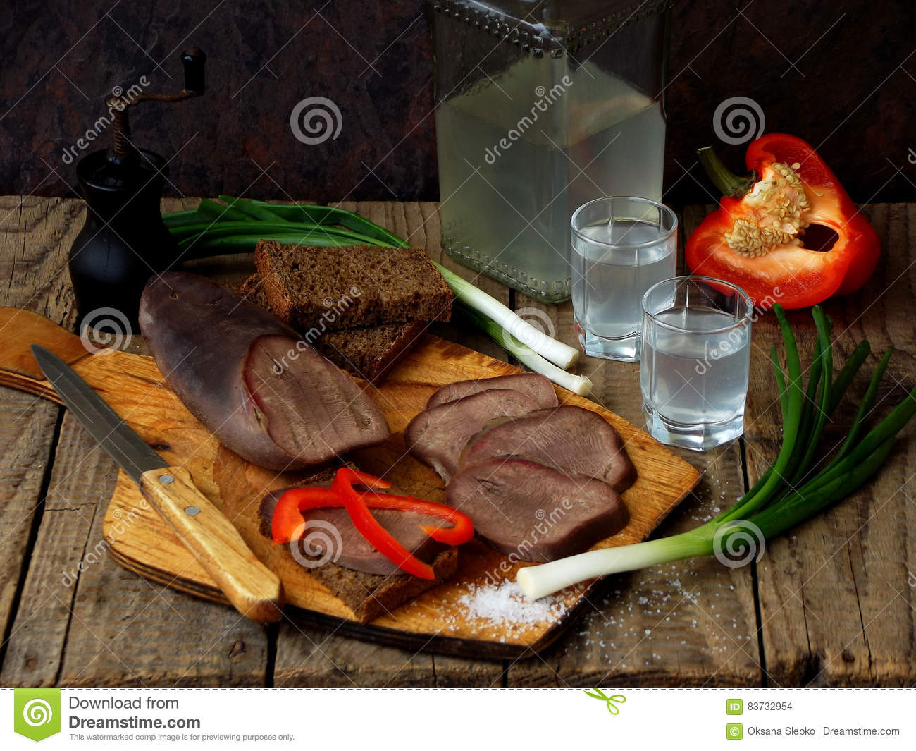 Neat`s tongue appetizer with vodka.