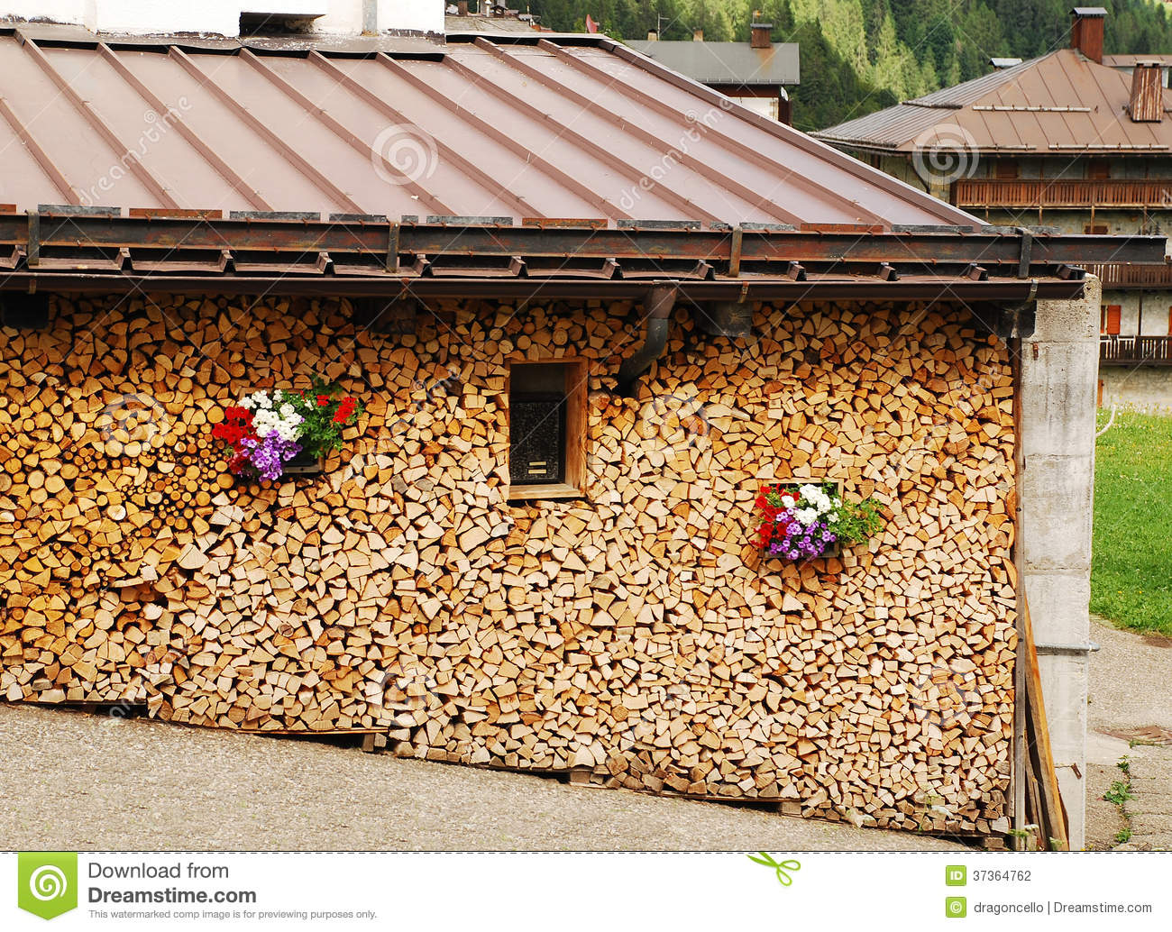 Neat Wood Stack With Flowers Stock Photography - Image: 37364762
