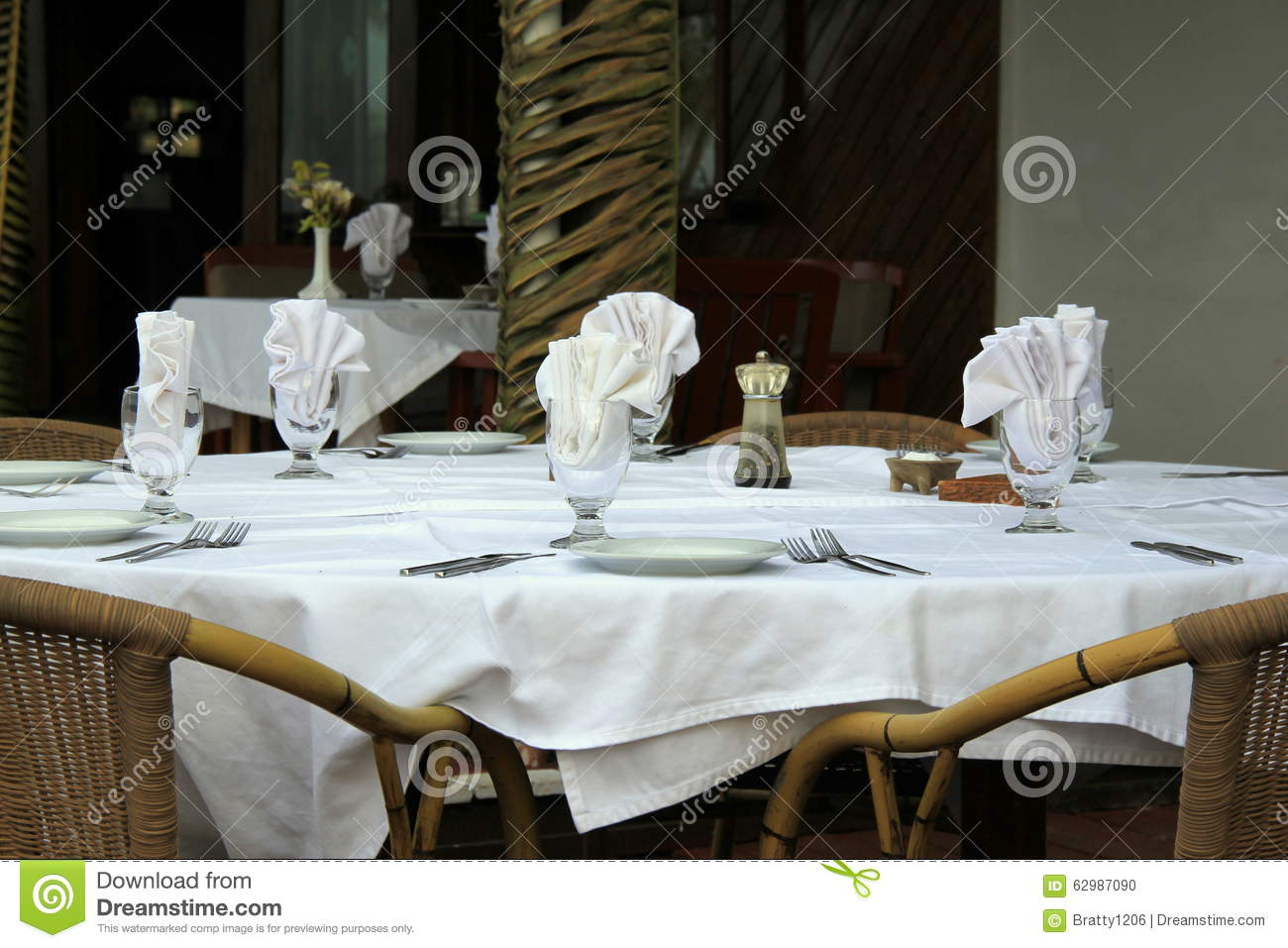 Neatly Arranged Table Setting At Outdoor Restaurant Stock
