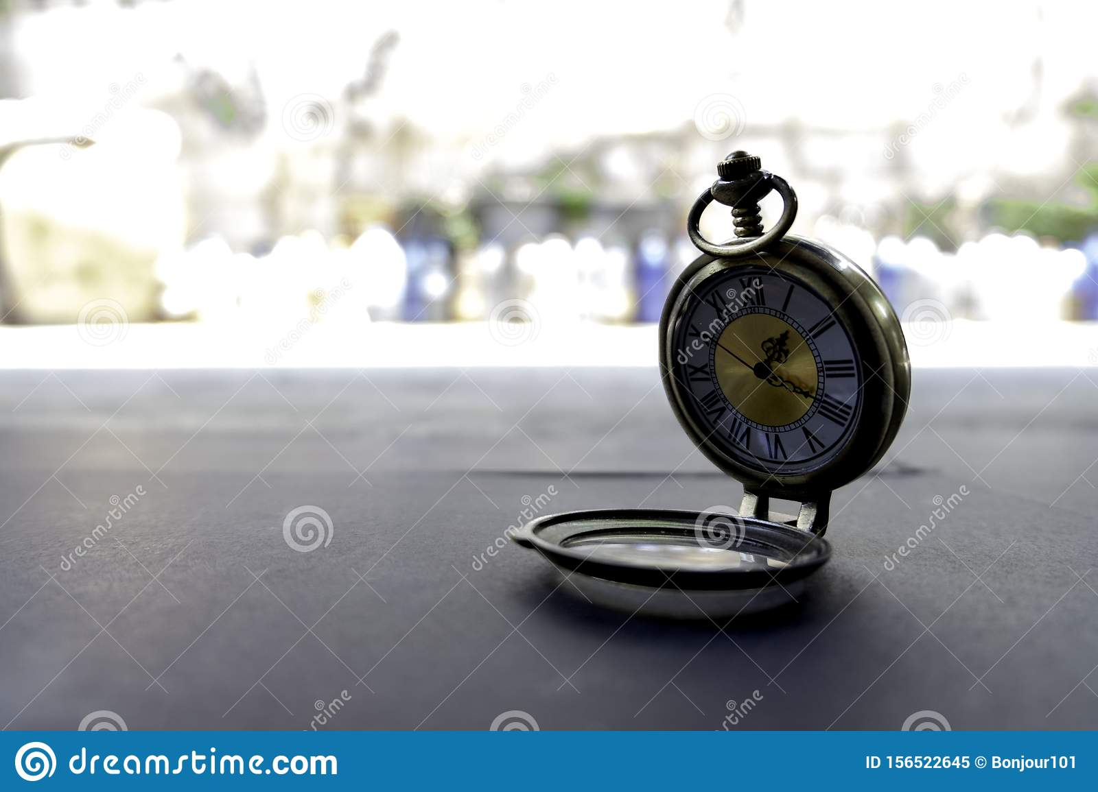 Necklace watches are located on black paper outside