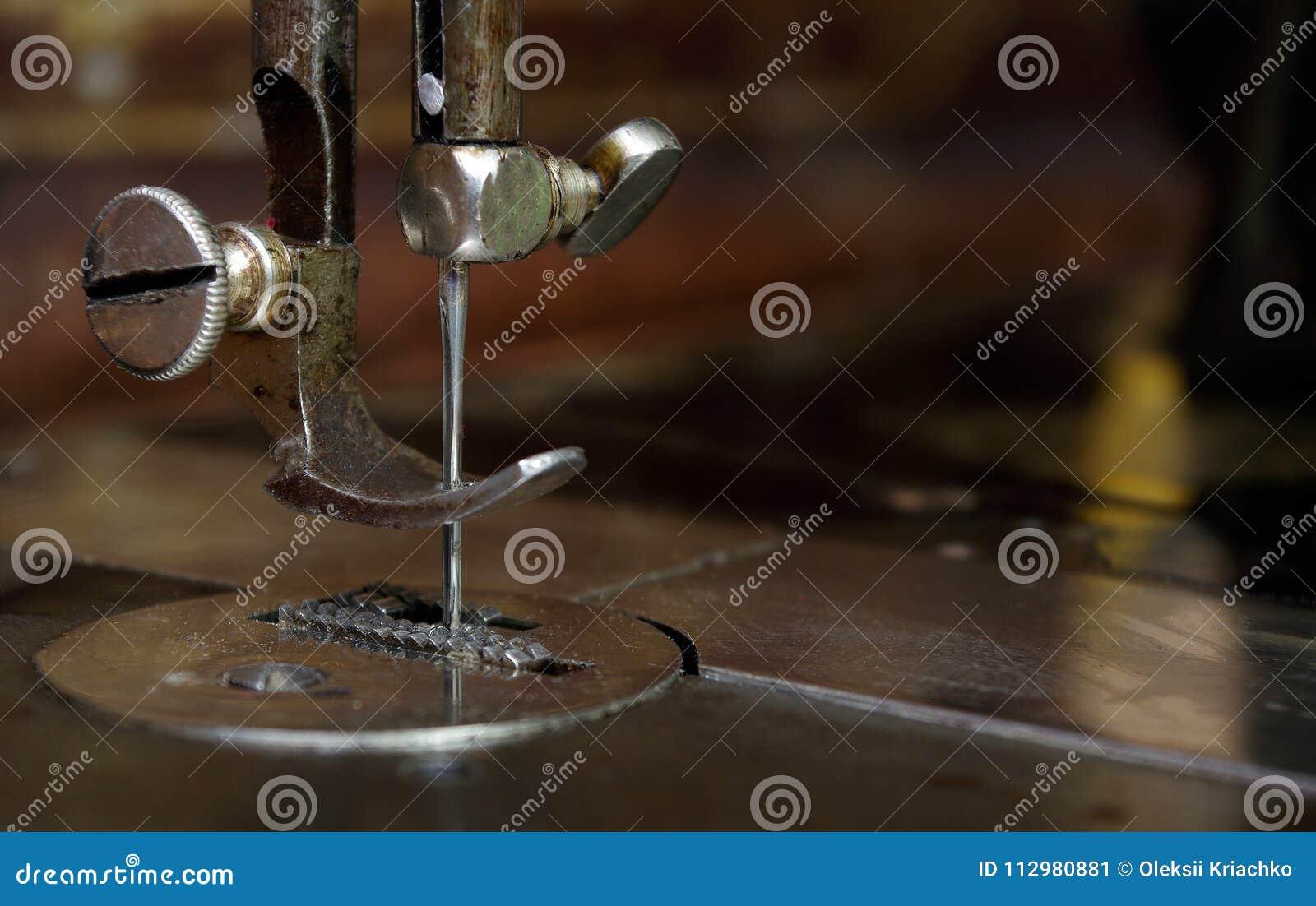 Needle sewing machine close-up.
