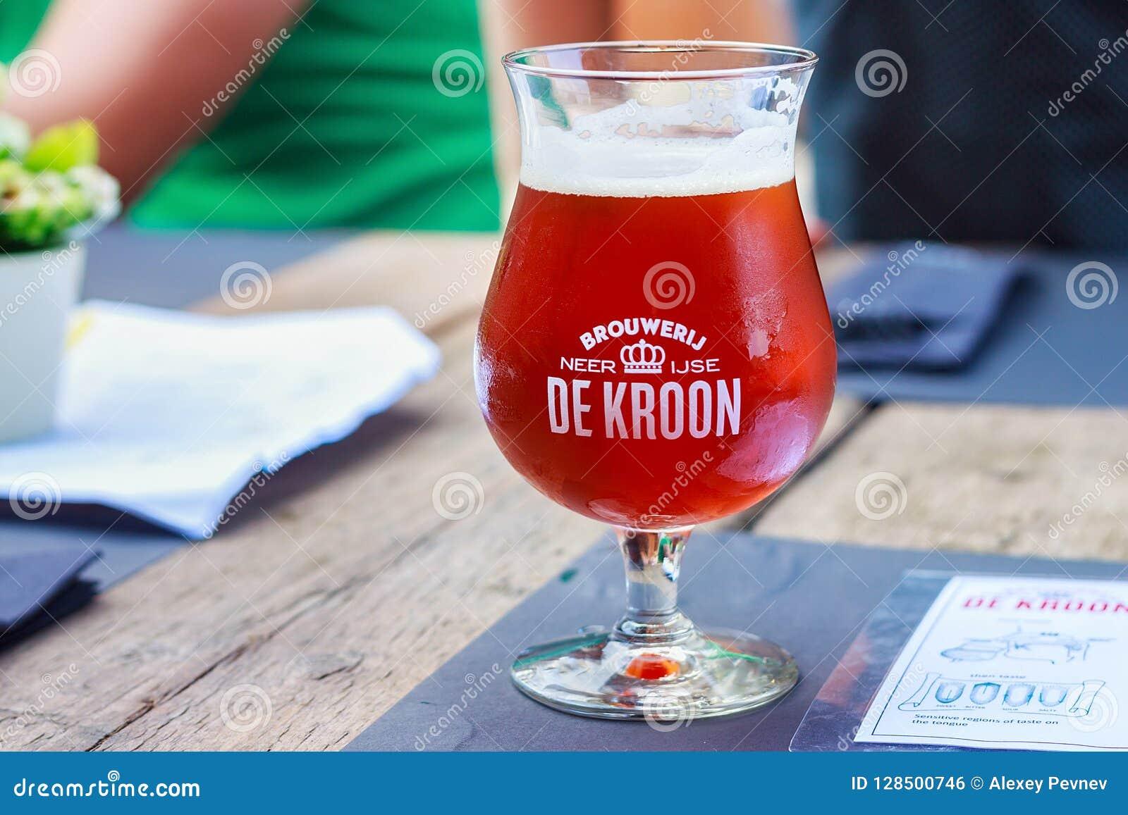 NEERIJSE, BELGIUM - SEPTEMBER 05, 2014: Tasting original beer of the De Kroon brand in same name restaurant.