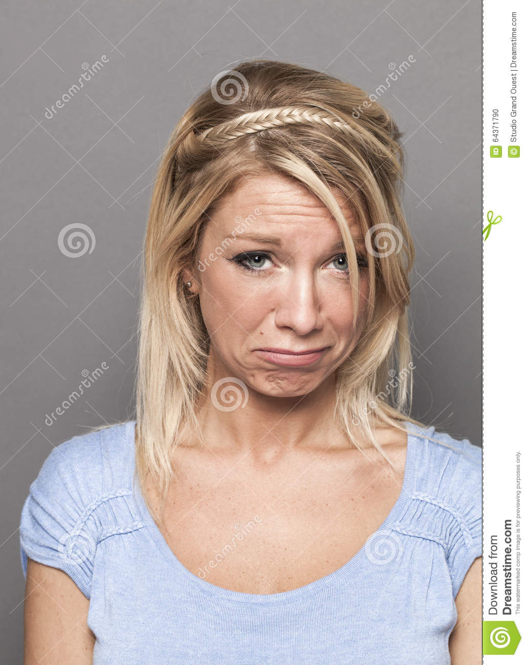 Blond Crying Teen Girl With Long Hair And Blue Eye Stock