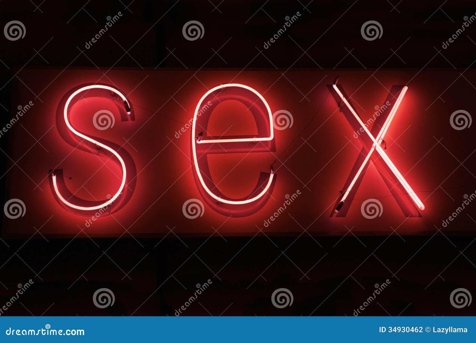 Neon rosso caldo del SESSO su fondo nero