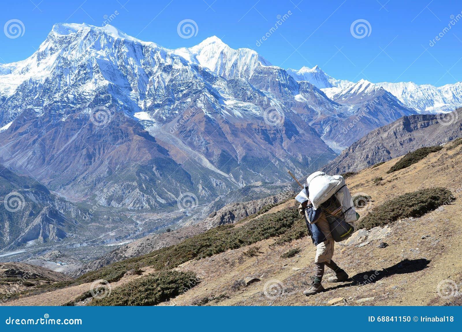 Nepal, Himalayas, November, 04, 2012. Tourist on a mountain trail in Himalayas